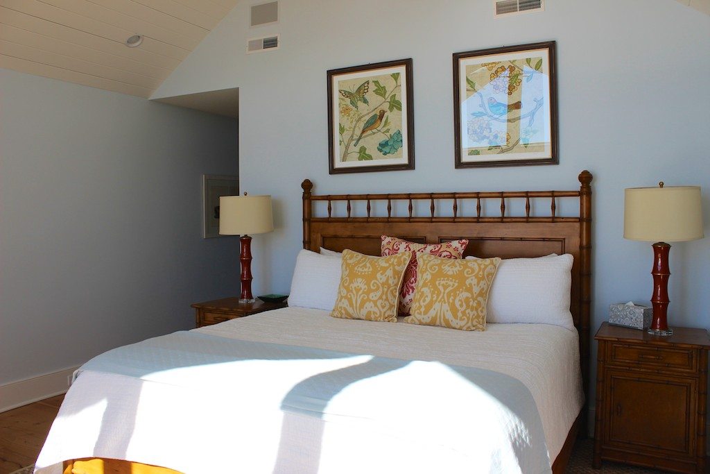 The master bedroom suite is on the main level. It has a king bed and high ceilings.