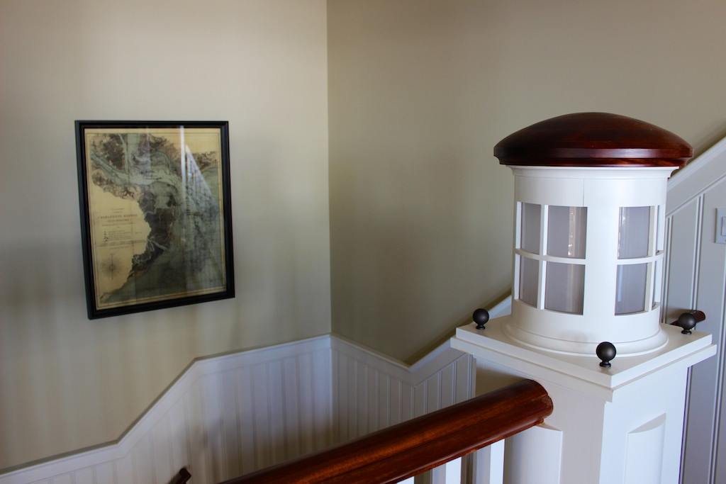 Take the stairs down to the family room and two additional bedrooms.