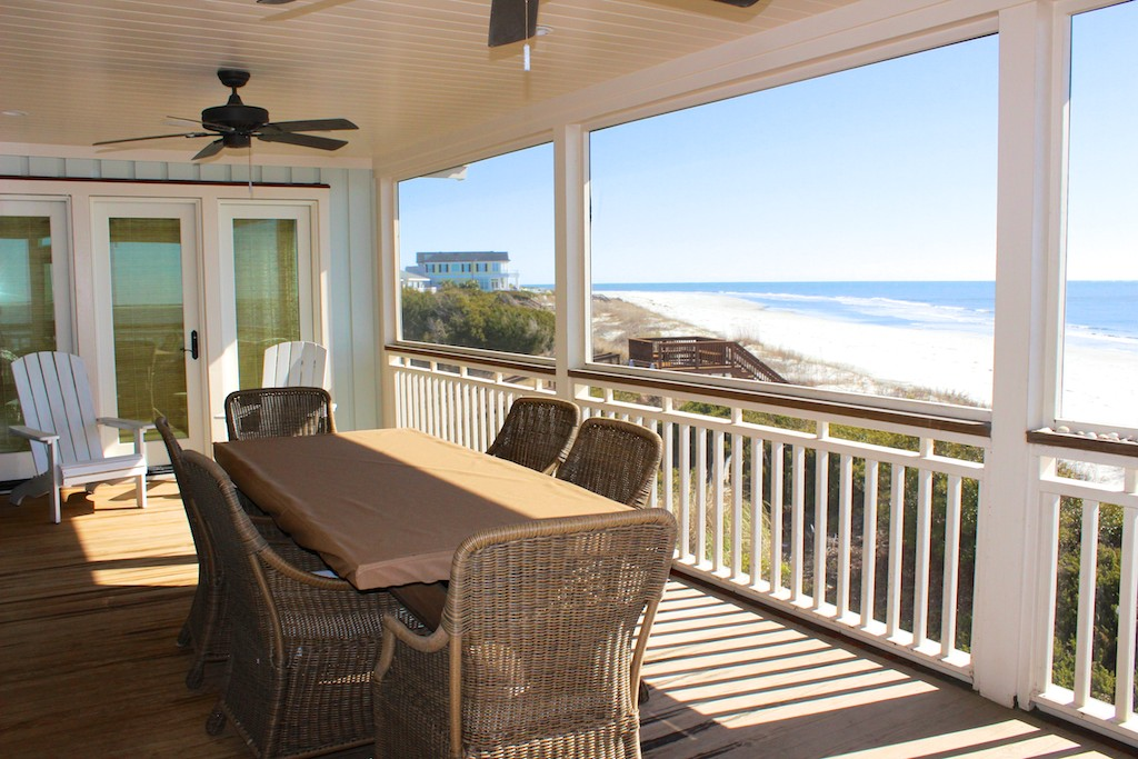 Step through one of the many French doors to the amazing screen porch.
