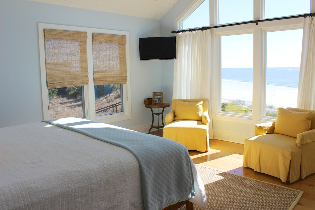 The wall of windows allowing ocean views from your bed. There is an HDTV too.