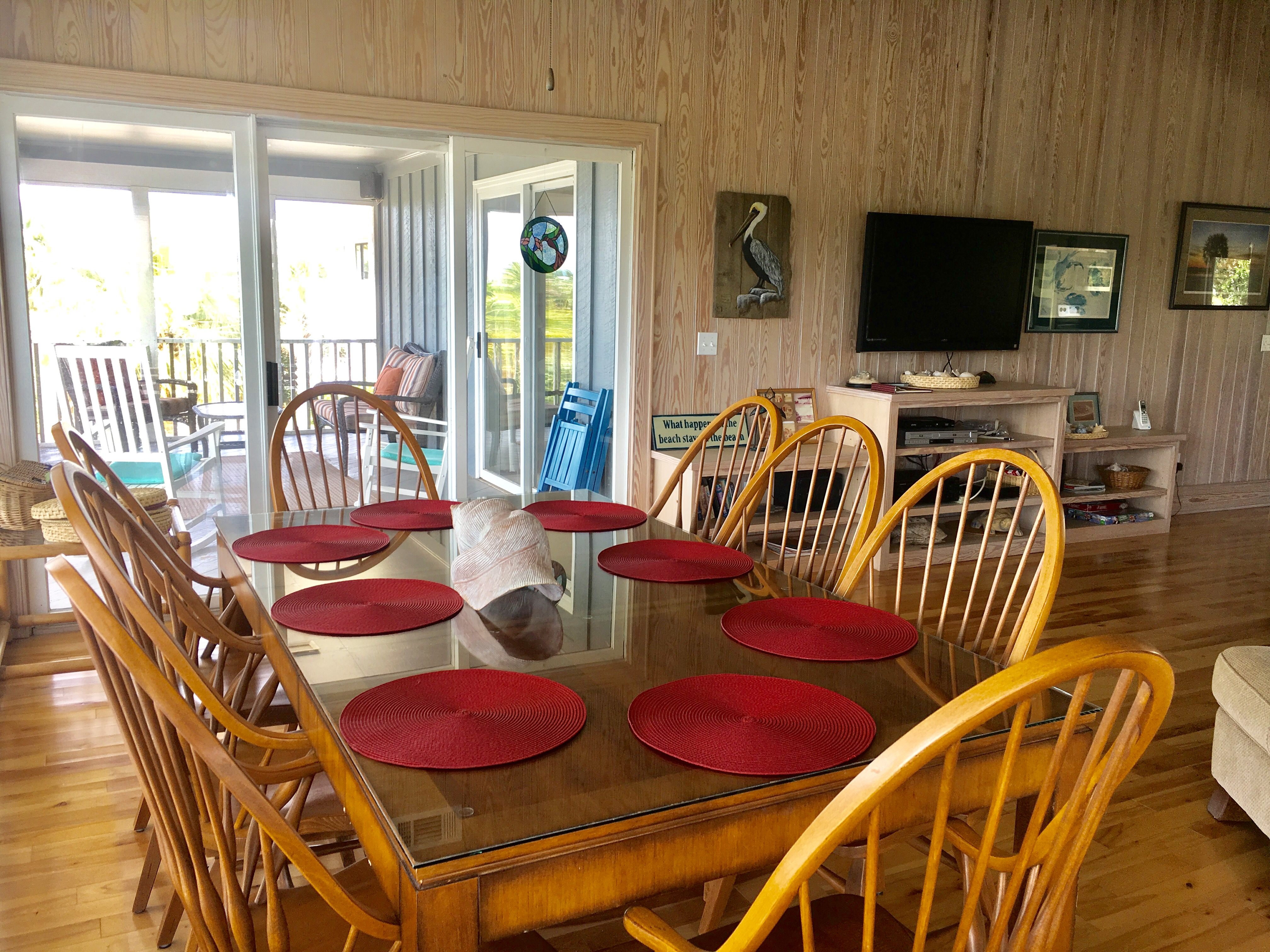 The dining area has a large table that seats 8 and has magnificent ocean views.
