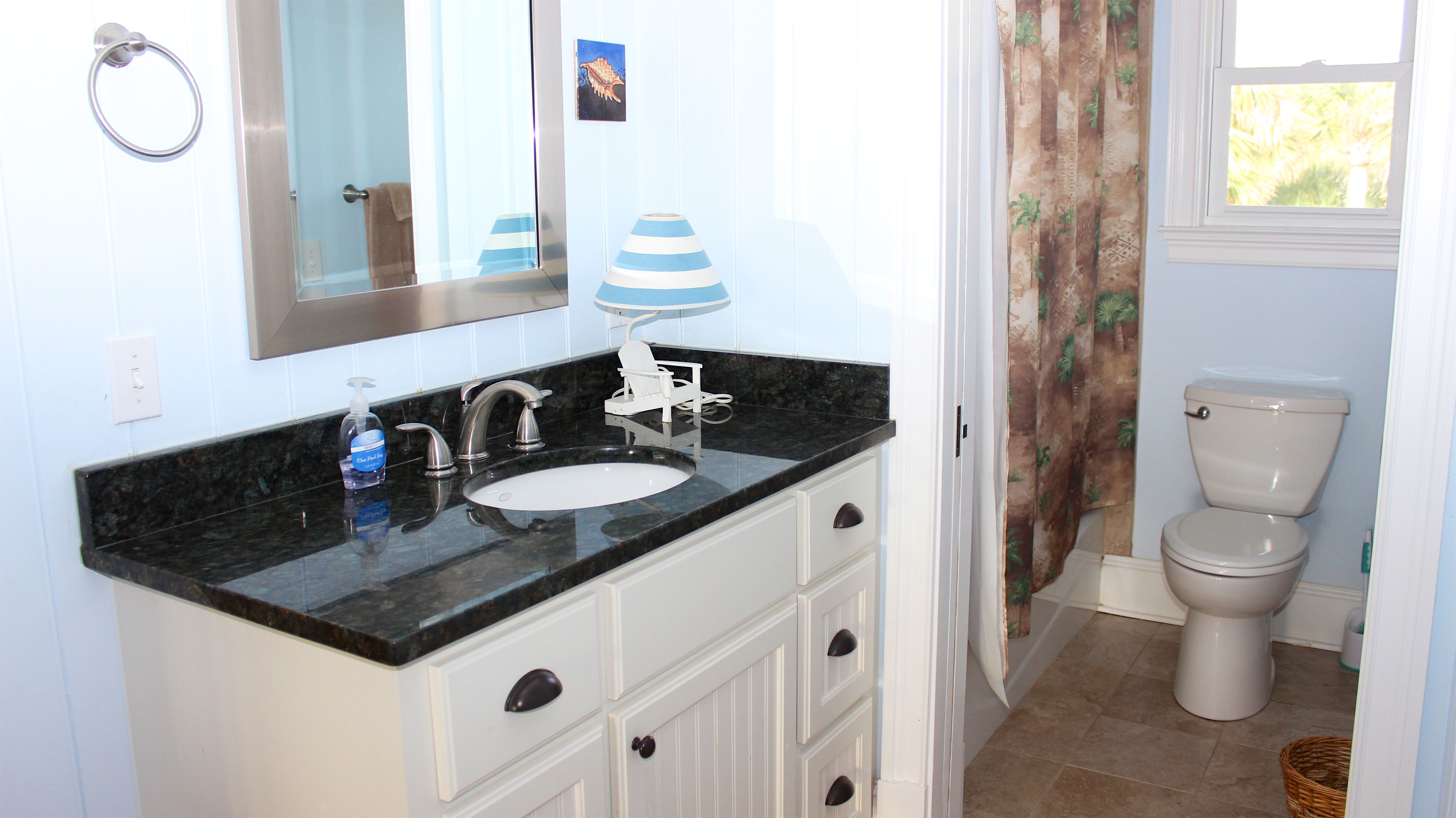 The full bath has a granite vanity & a separate toilet/tub/shower area.