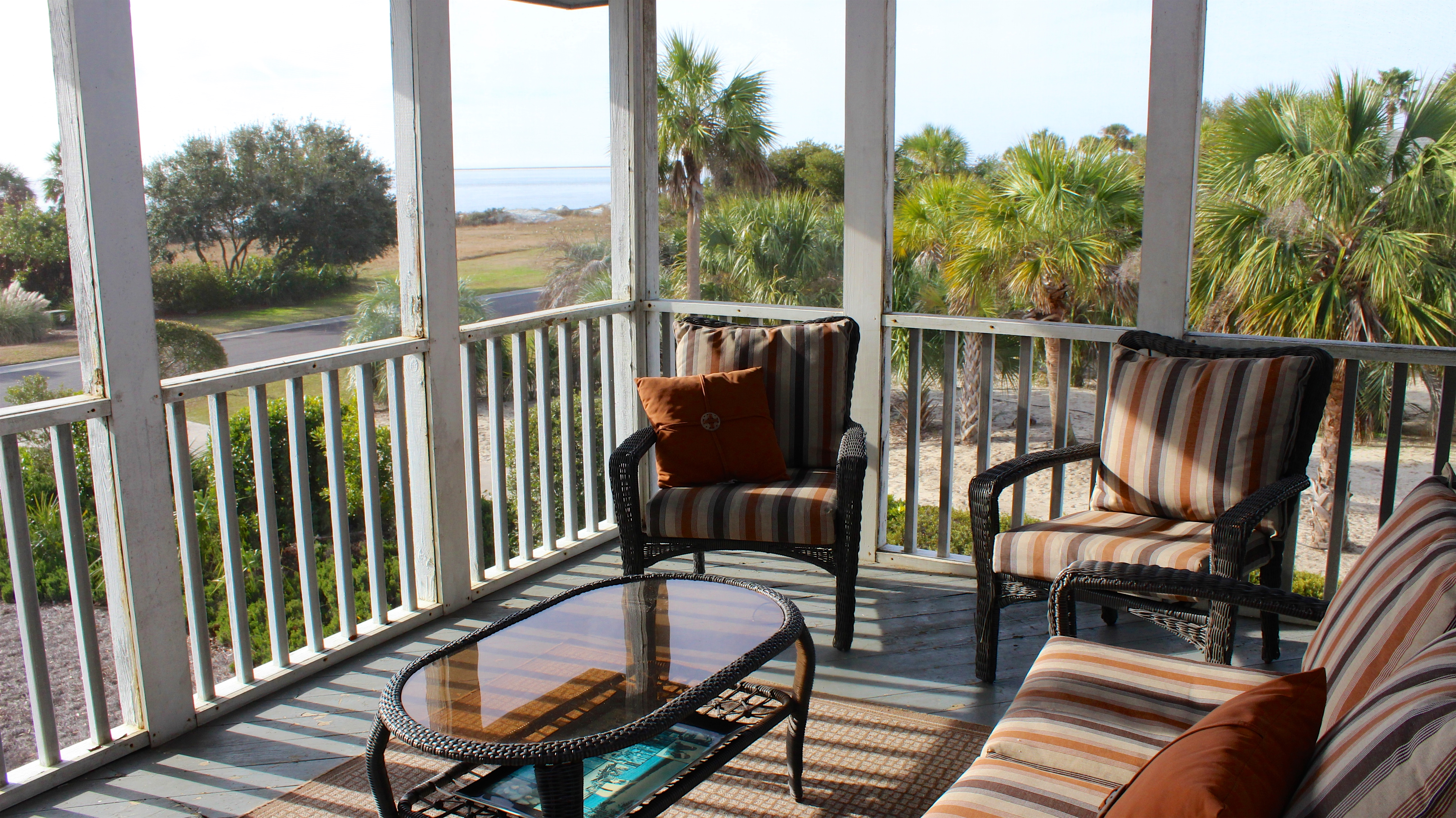 Sliding doors lead to a screened porch with ocean views.