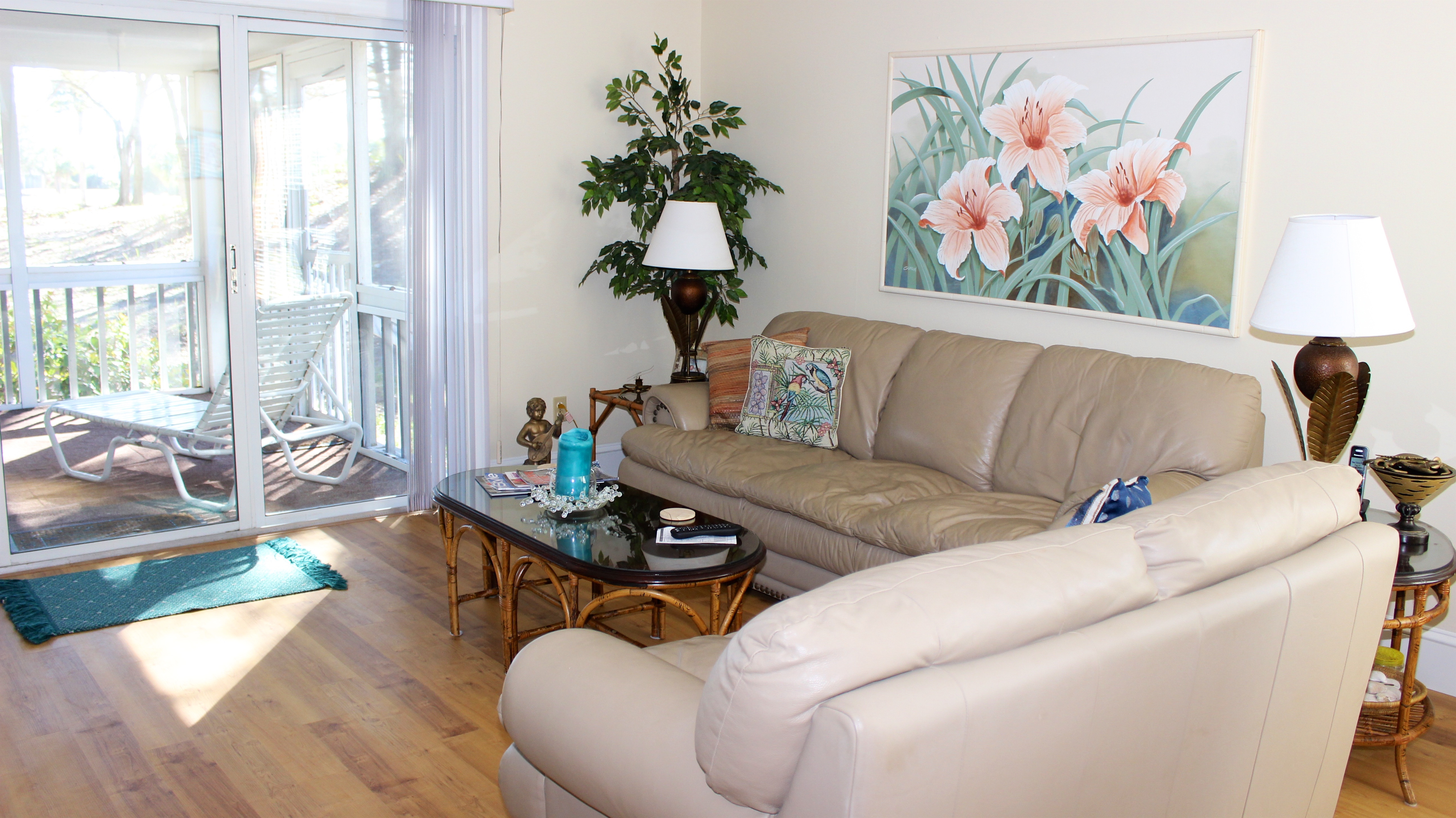 Light and spacious, features include hardwood floors and comfortable furniture.