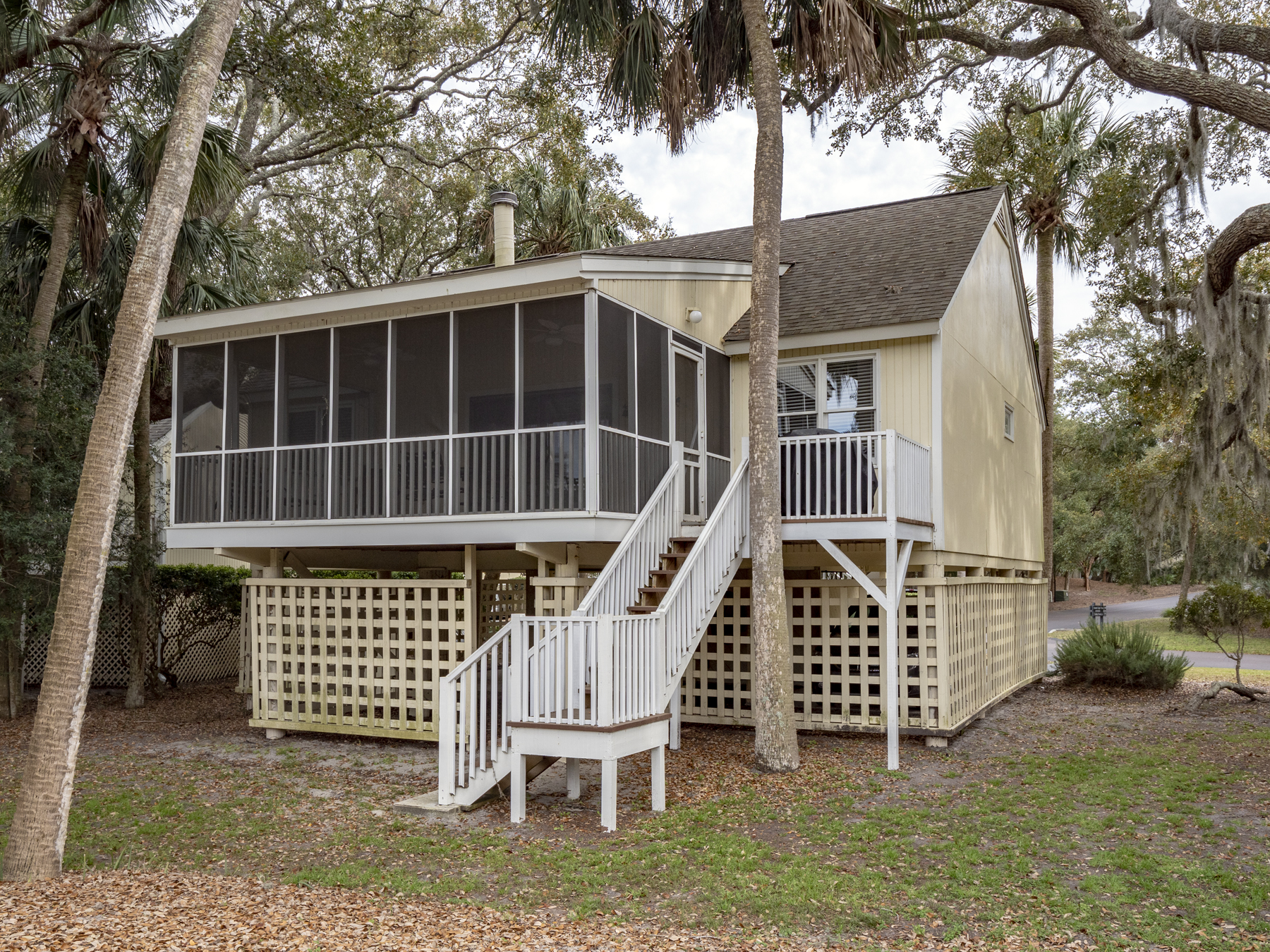 Enjoy the outdoor living space of the screened porch with views of Ocean Winds Golf Course