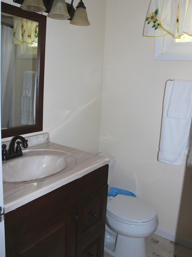 Between the two bedrooms is a renovated shared bathroom with a tub/shower.