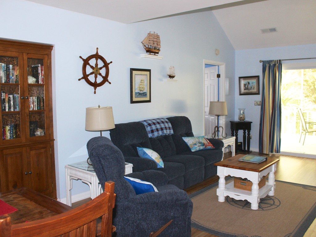 This home has been recently updated with new hardwood floors and furniture.