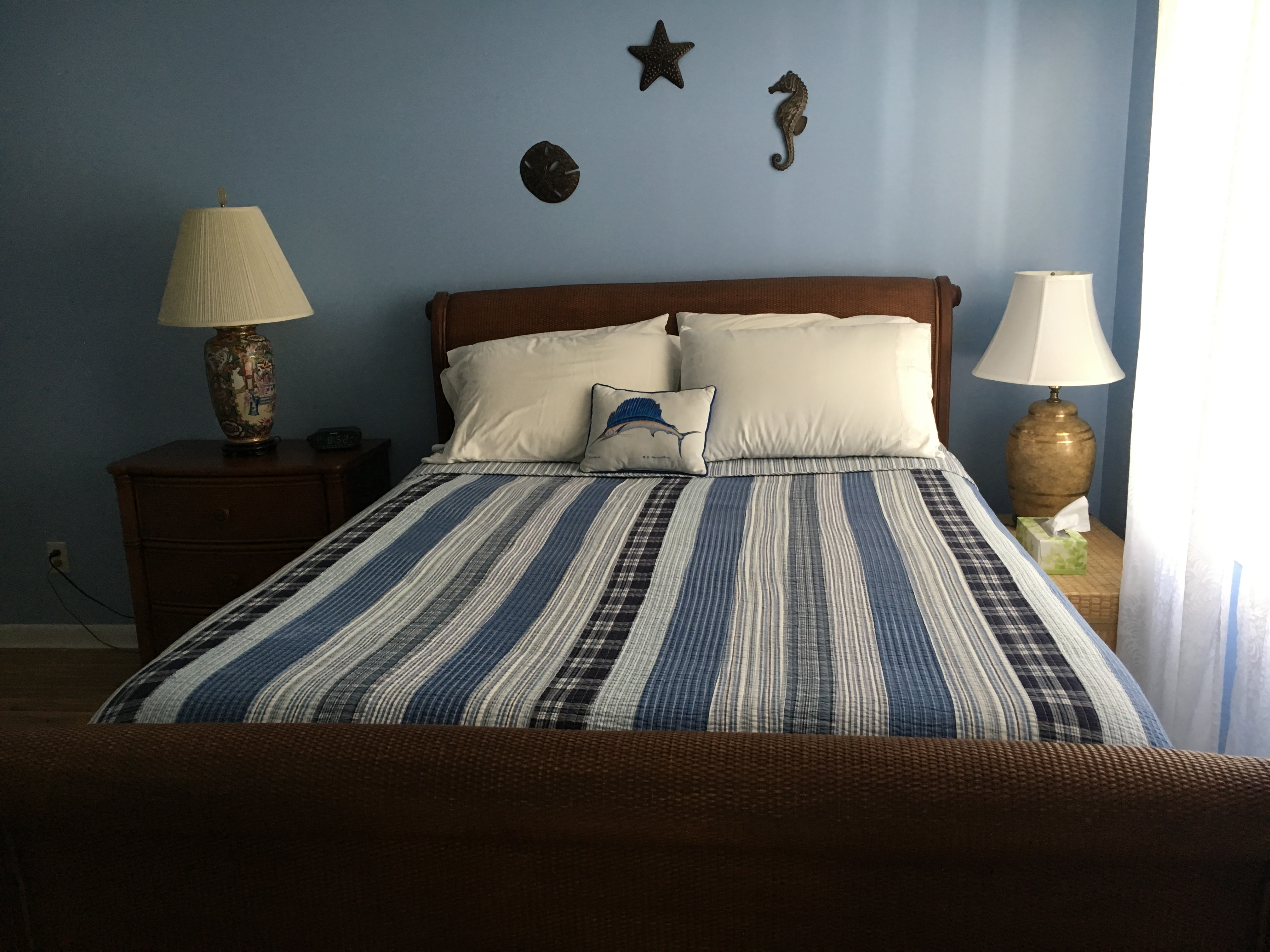 The master bedroom is off the living room and has a queen bed.