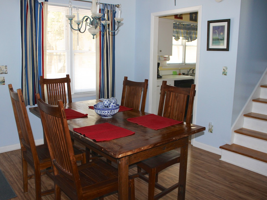 The nearby kitchen makes it easy to serve meals.