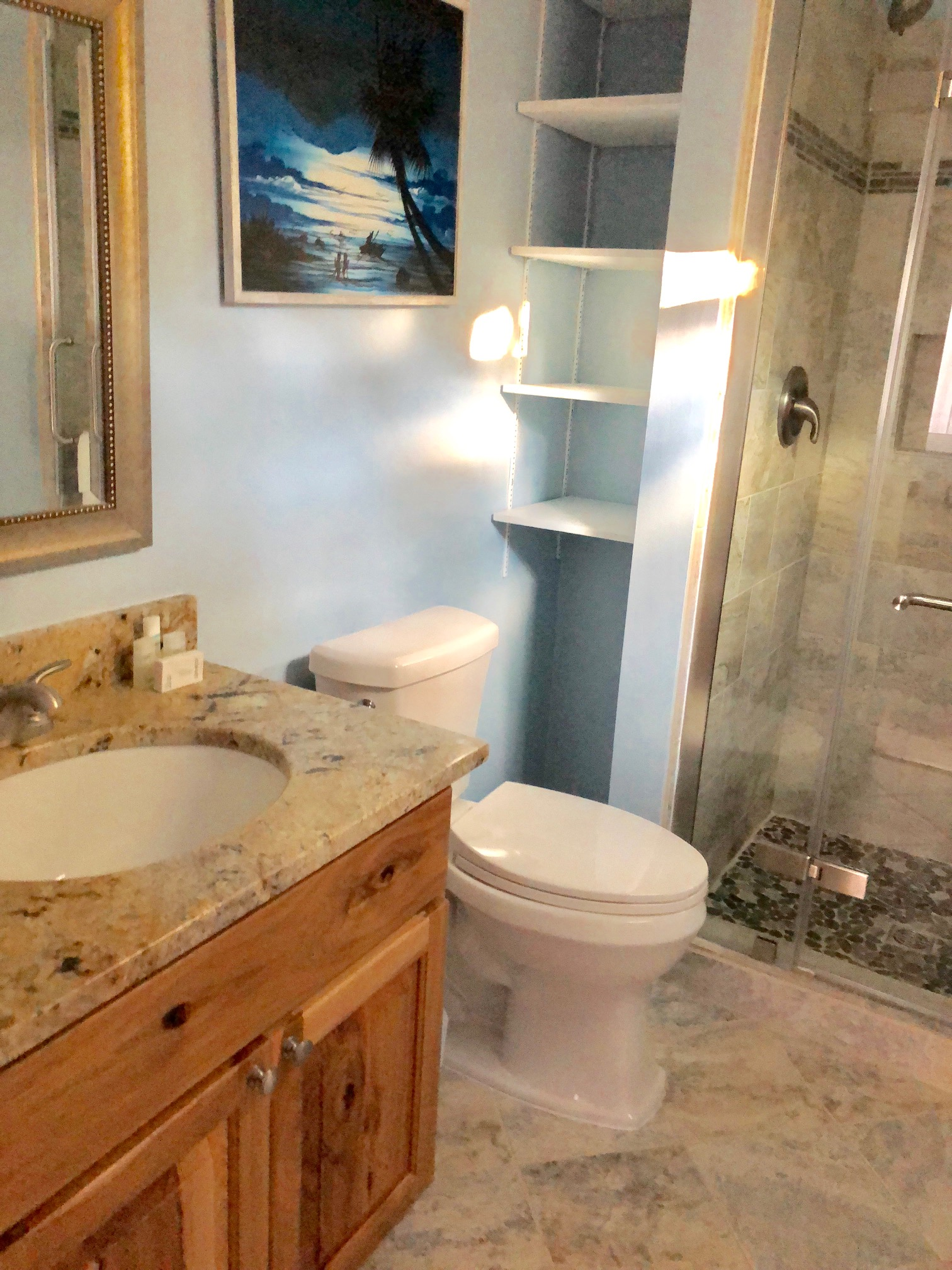 Newly renovated master bathroom with tile flooring and shower.