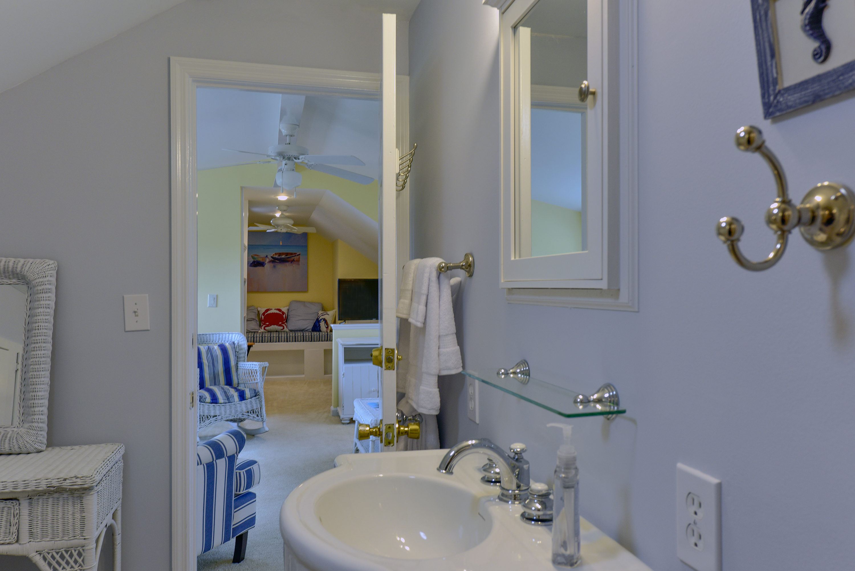 A 3rd full bathroom is up in the loft.  There is a tiled shower and a porthole allowing plenty of sunlight.