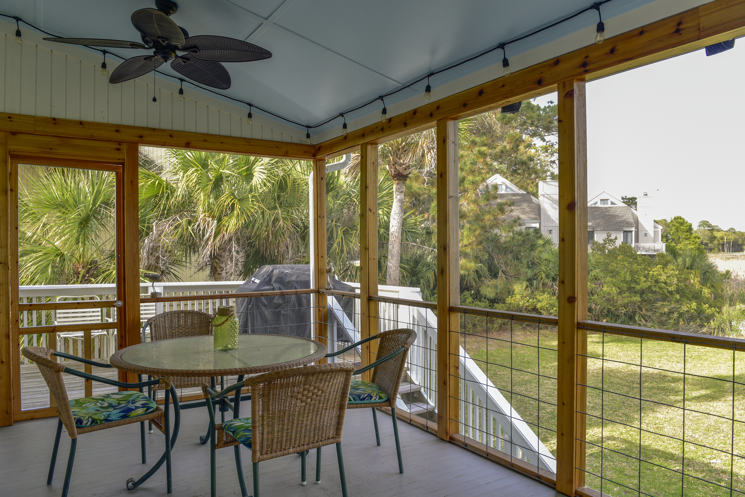 A dining table on the screen porch is the perfect spot for dinner -- additional chairs to accommodate a total of 6 people.