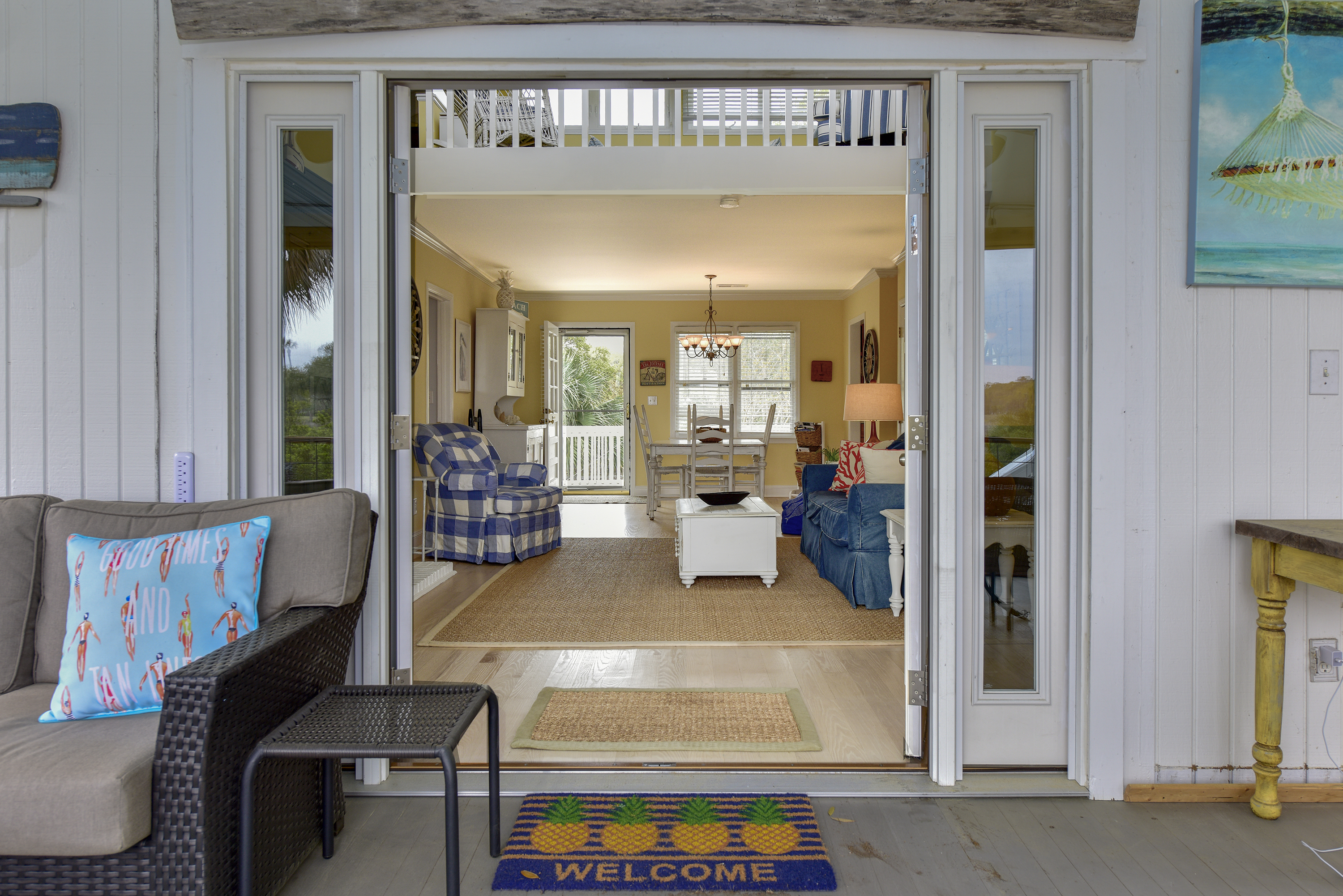 This cottage flows beautifully from front door out to screen porch.