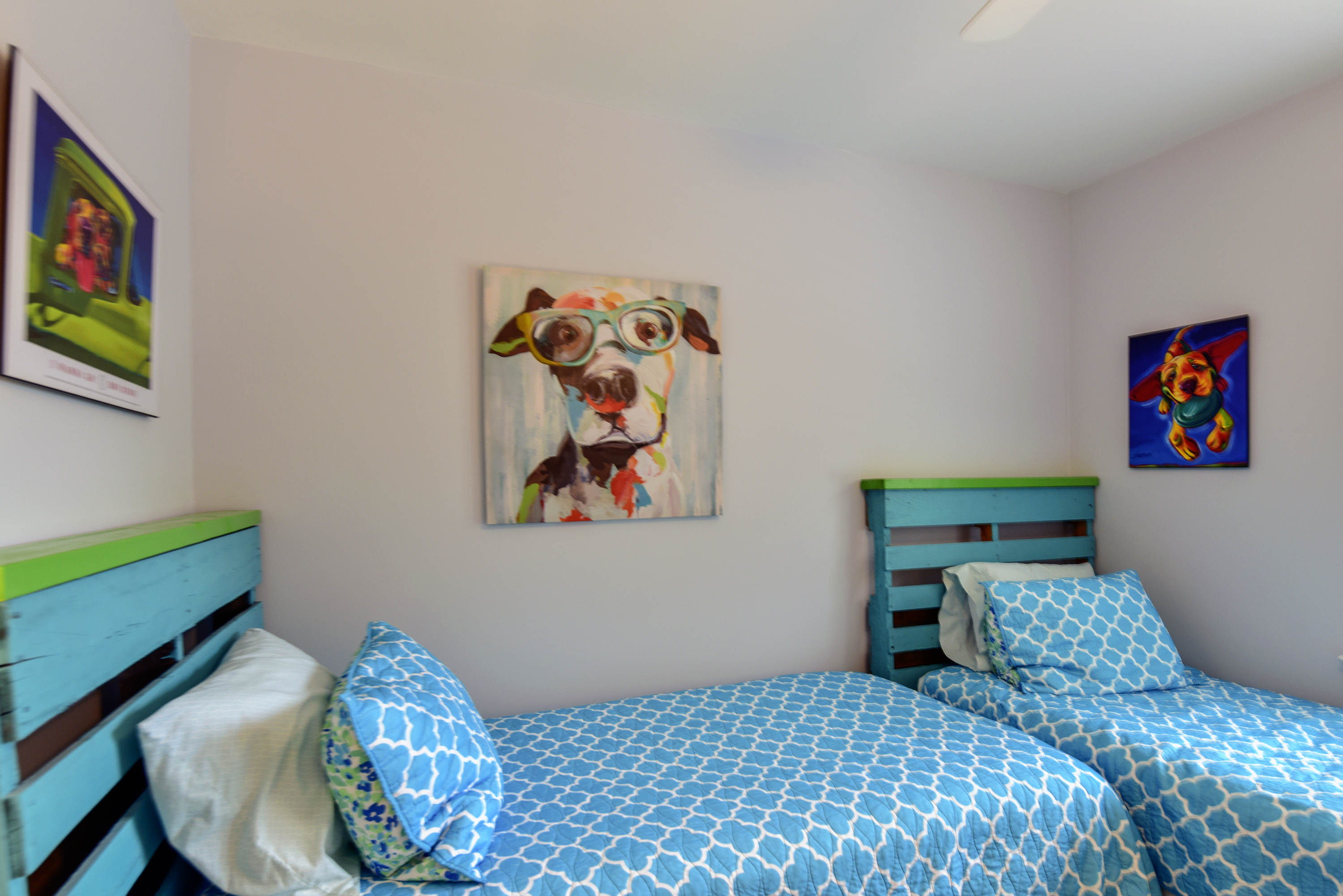The second guest bedroom has two twin size beds.