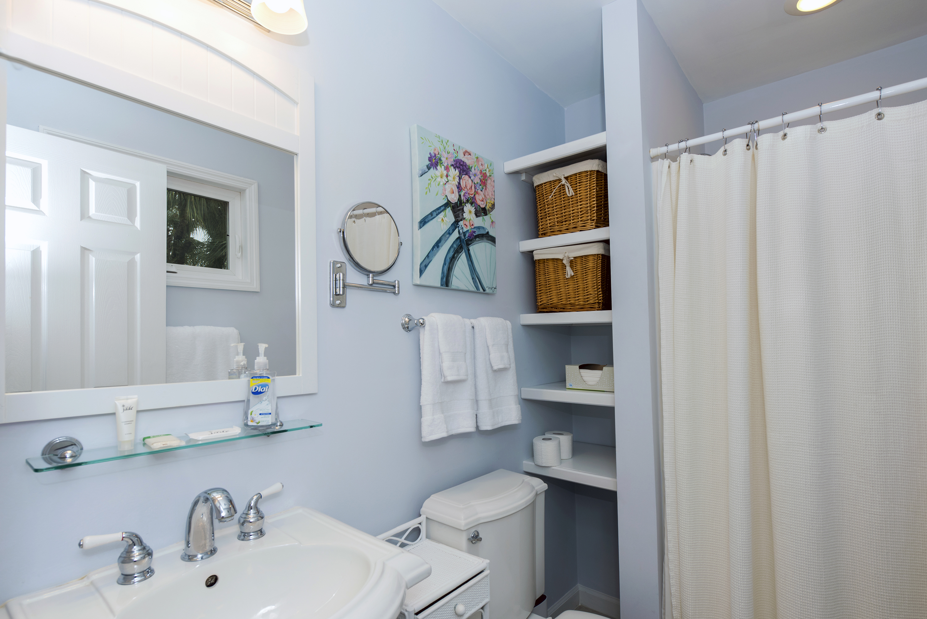 The master bath has a pedestal sink and shower.
