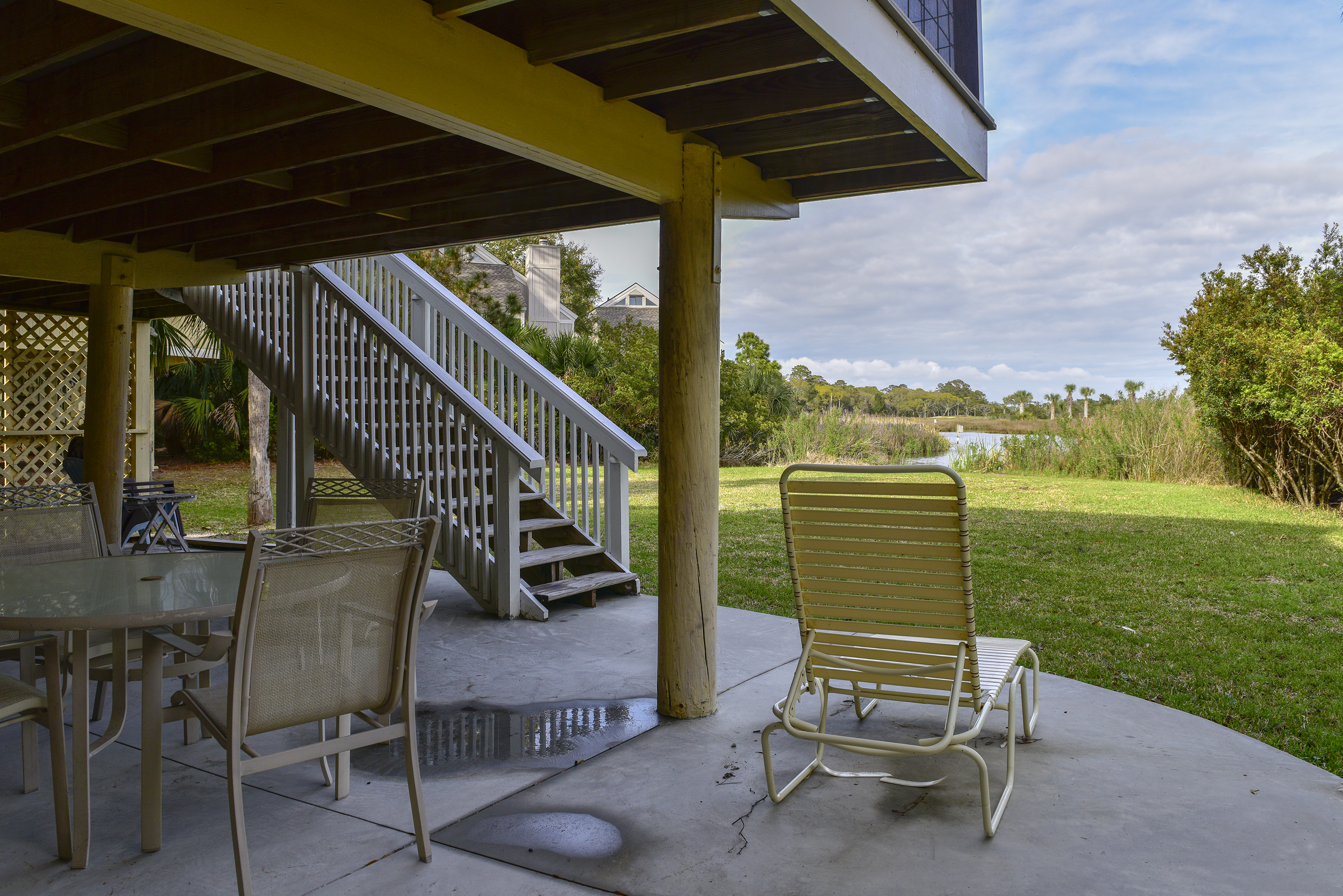 The patio has space for a quick lunch in between beach time or an afternoon nap on the chaise.