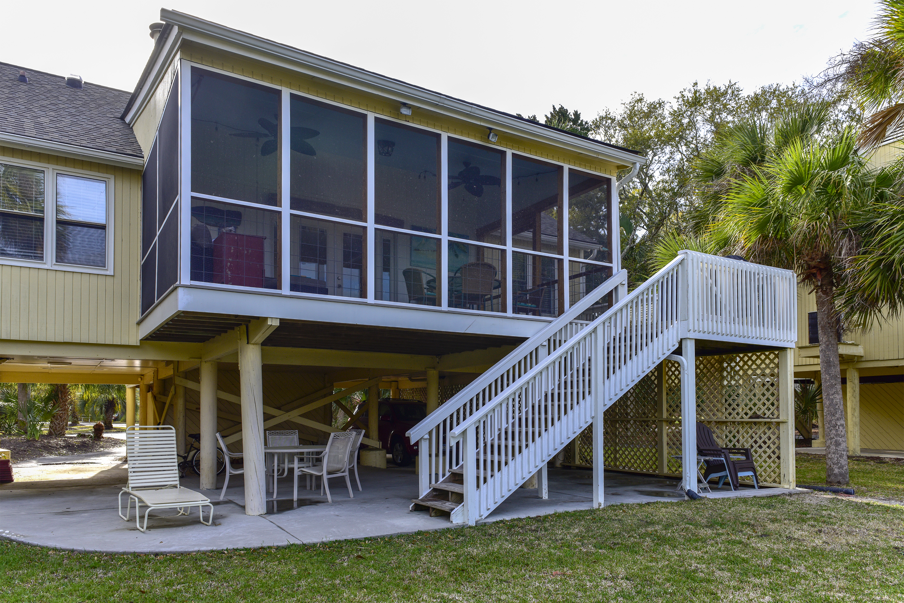 Your Tarpon Pond rear exterior showcases the screen porch and patio area.