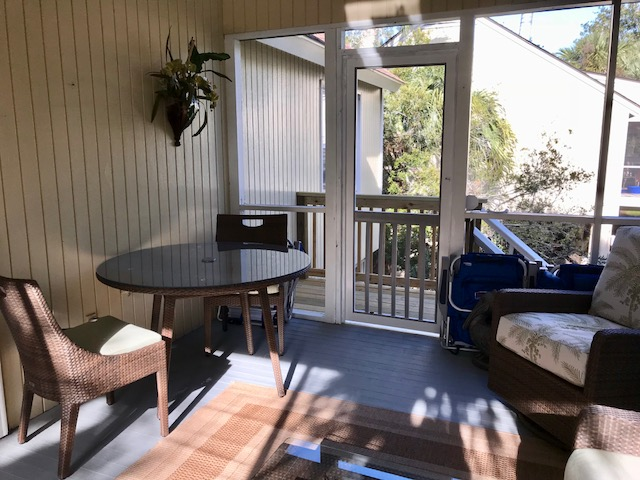 A bistro table to enjoy your morning coffee or a cool drink. The screen door opens to the back stairs which lead to the yard and carport.