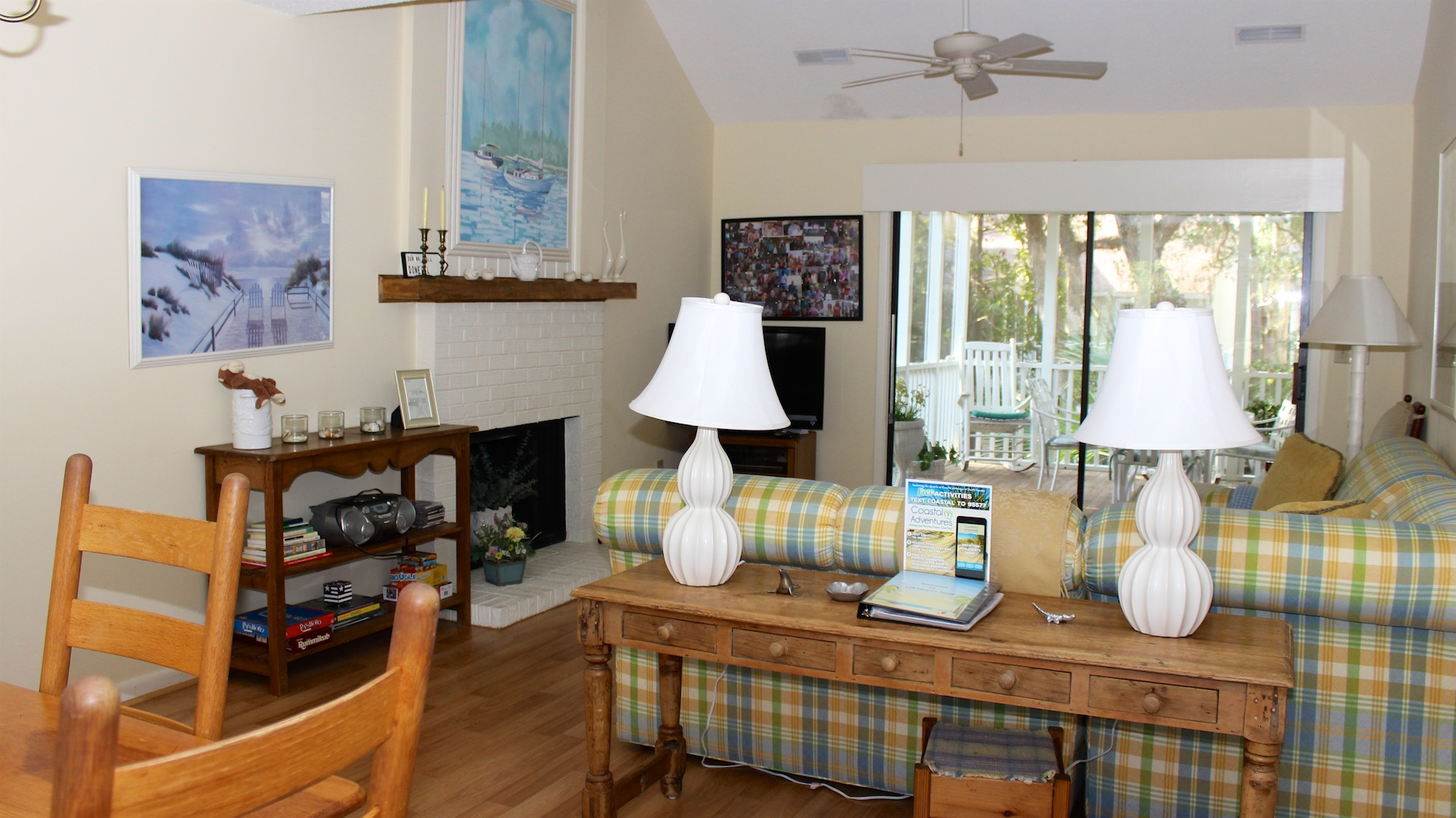 The cottage features an open dining/living area, hardwood floors, and cathedral ceilings.