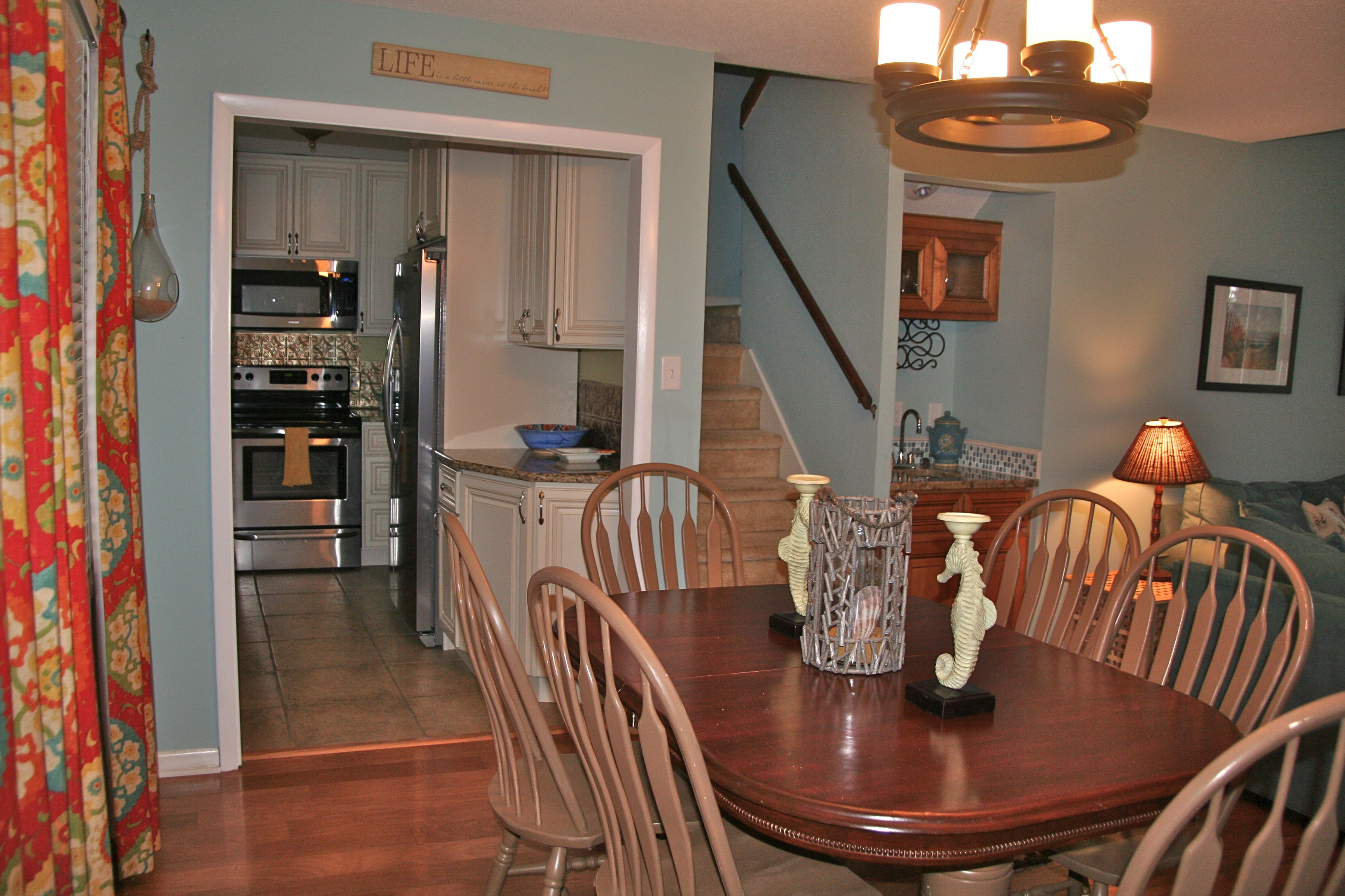 The dining room area seats 6 and is steps from the kitchen and the living room.
