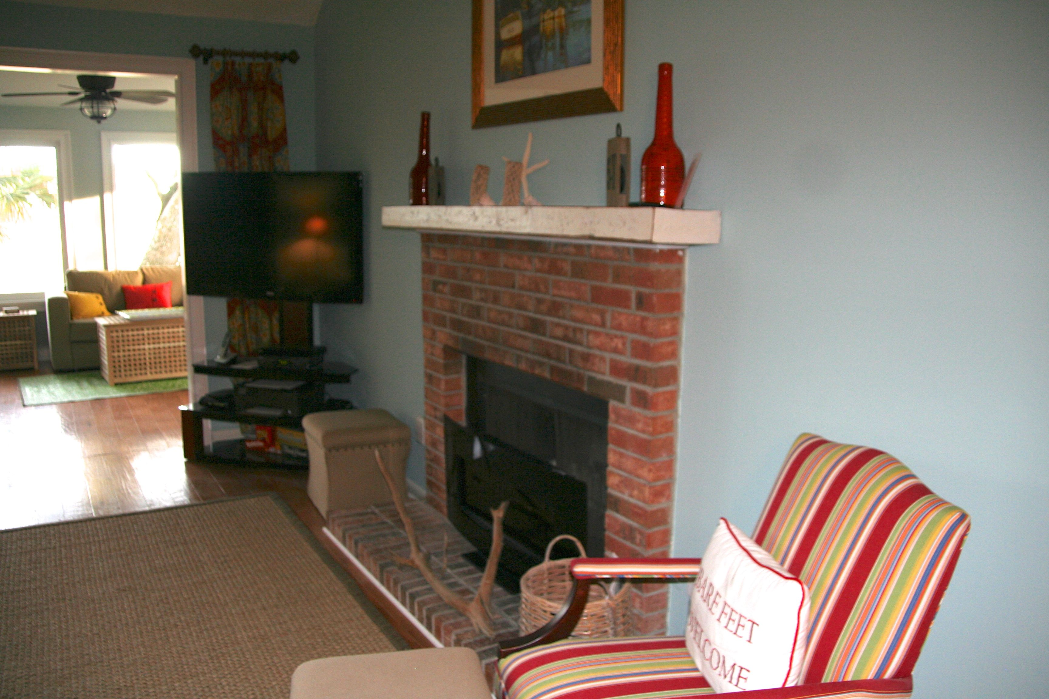 There is a large TV and fireplace and sun room.