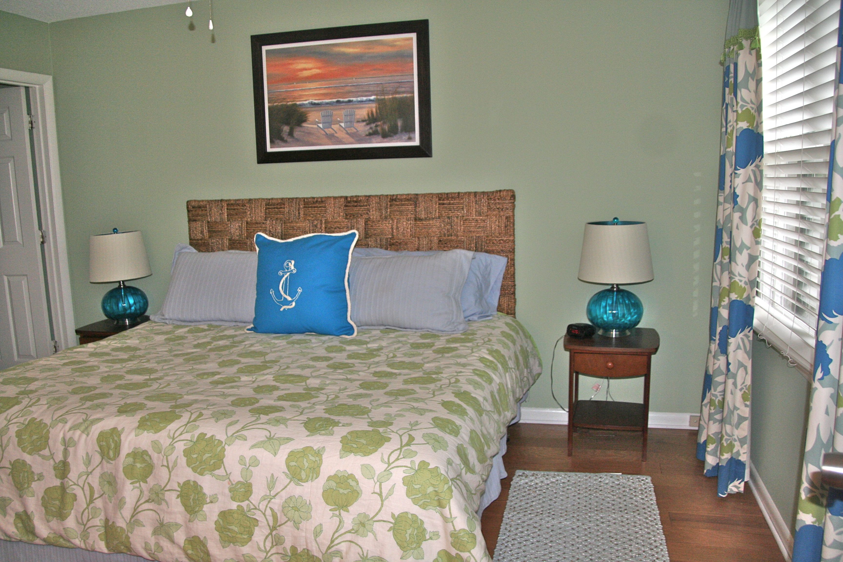 The master bedroom is on the first floor and has a king sized bed.