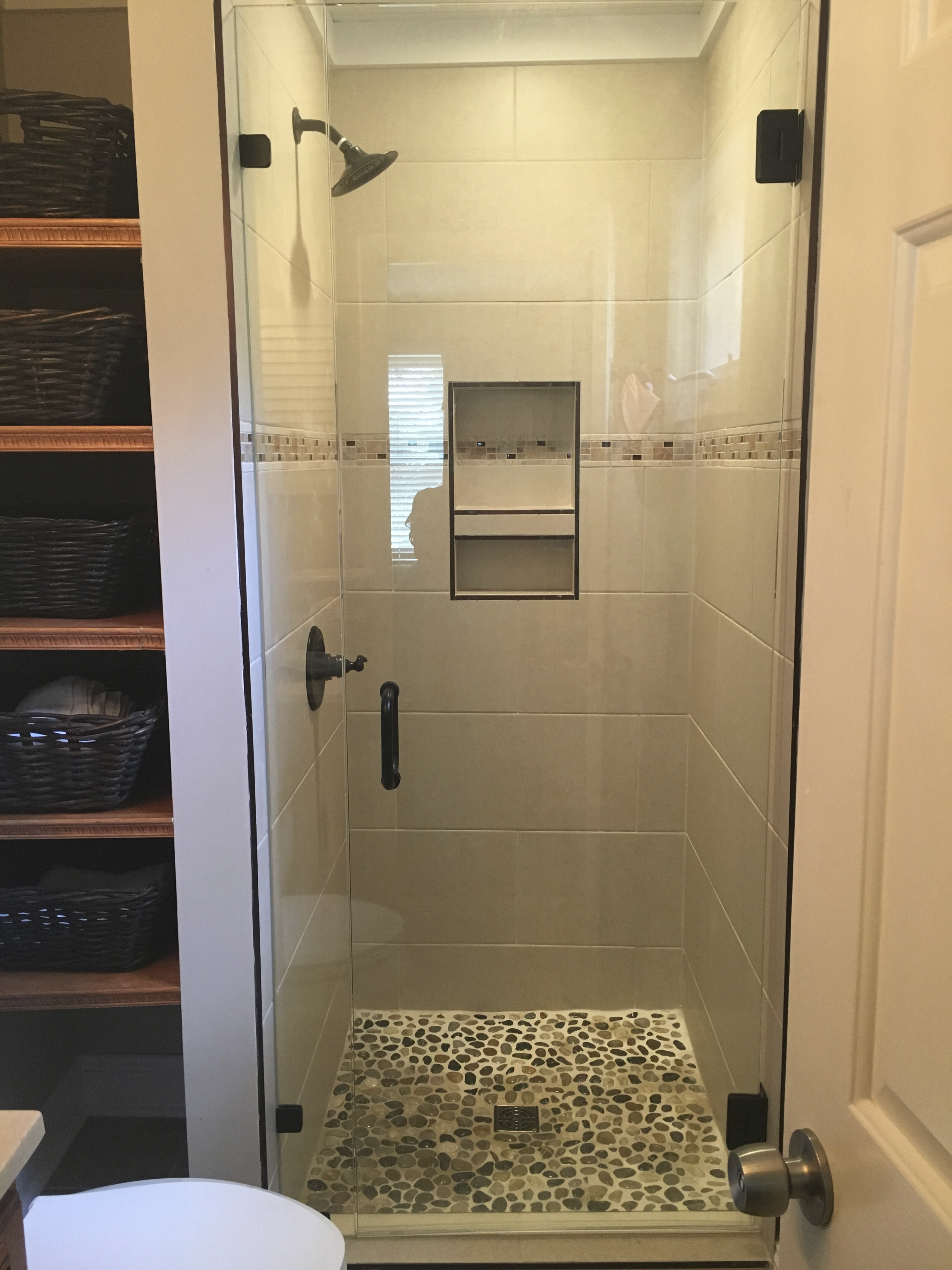 The newly updated master bathroom is en suite and has a walk in shower with a spa like pebble floor.