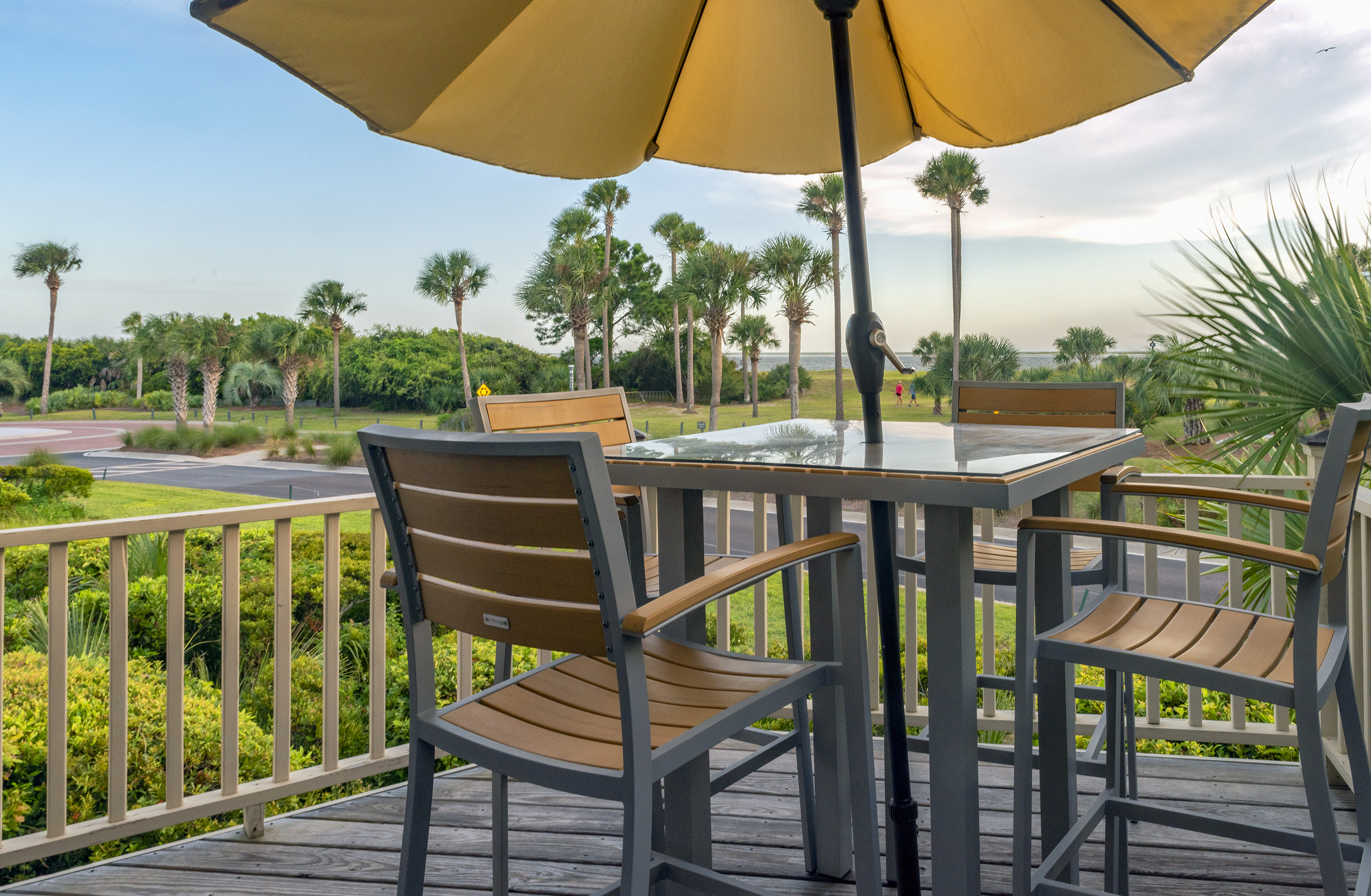 The deck overlooks the ocean, beach, and Deveraux Banks across the waters.