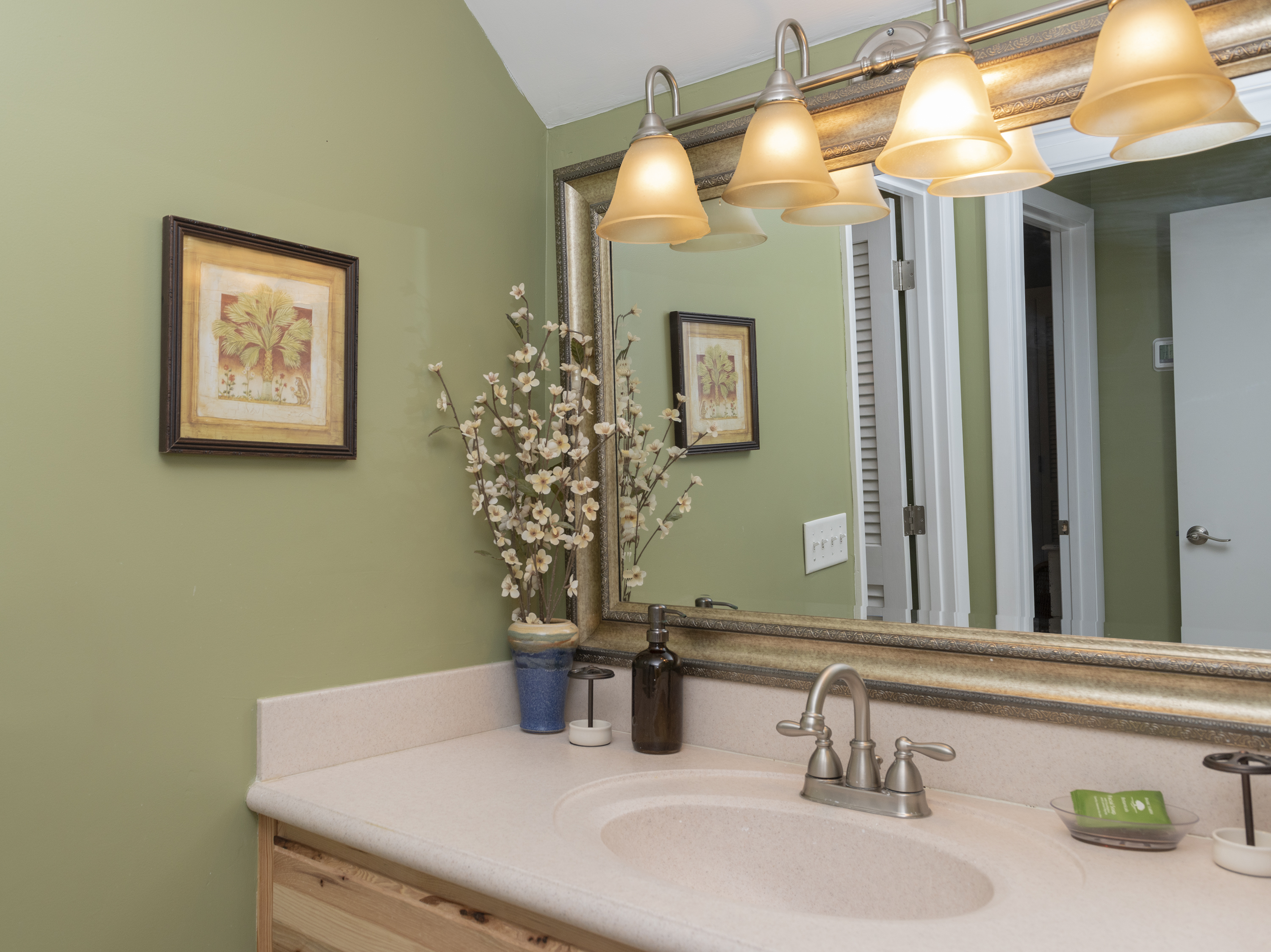 The hall bath is between the two bedrooms & has an updated cabinet and vanity.