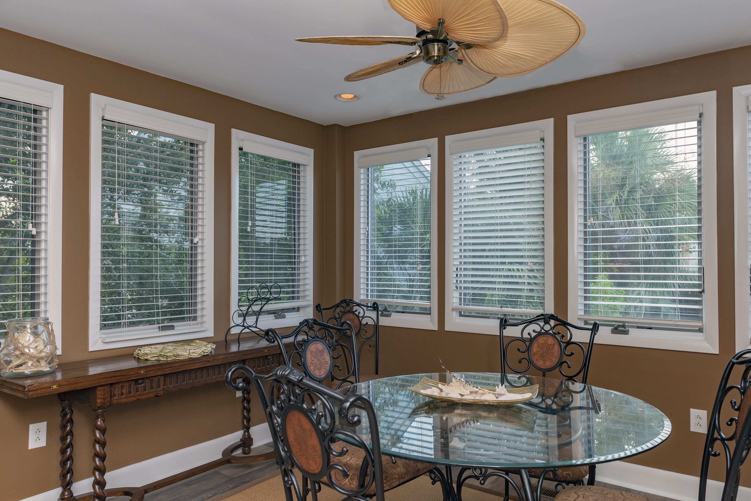 Surrounded by windows, the dining room has a table for 6.