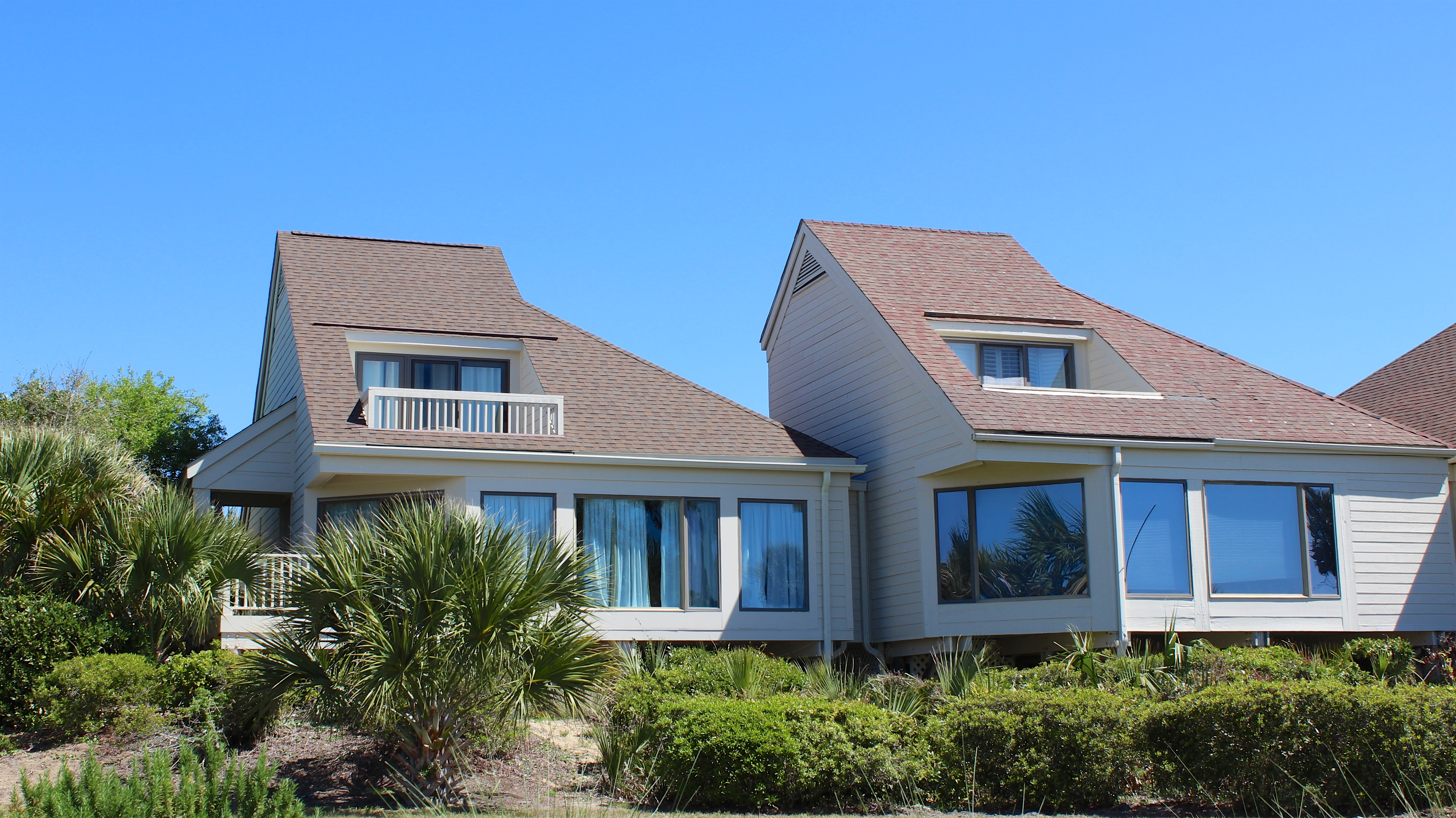 Walk to the beach, golf, dining, and pools from this end unit townhome.