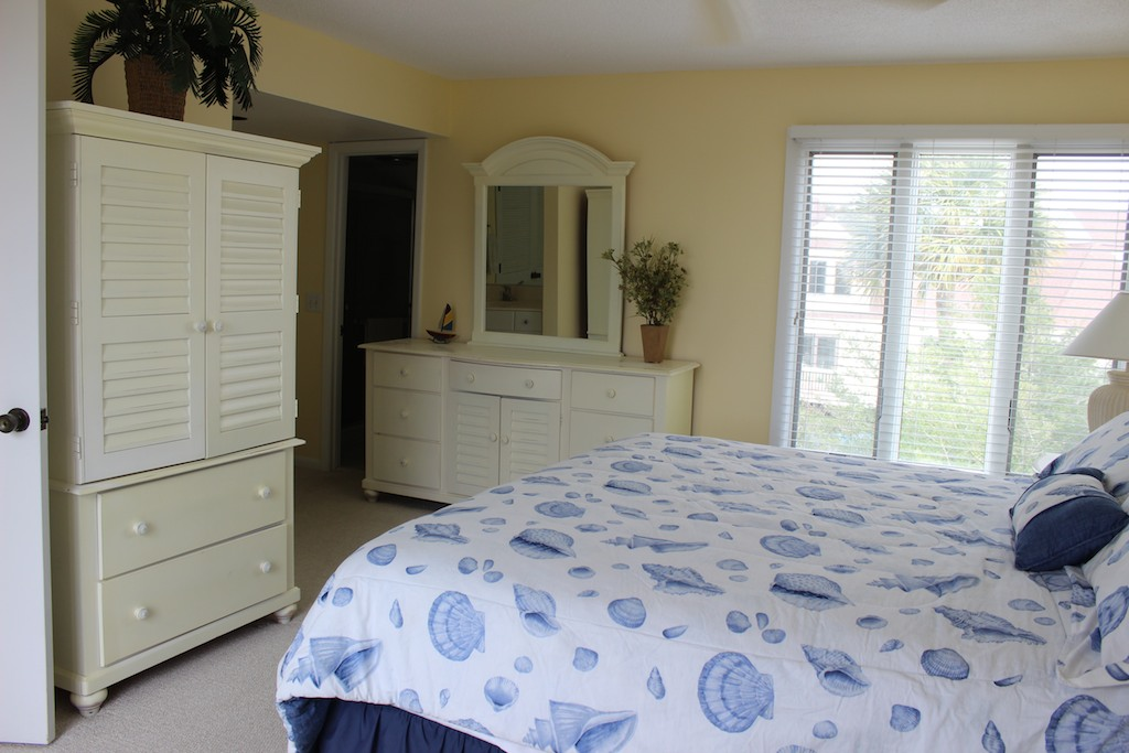 The armoire has a TV. There are two sun decks off this bedroom.