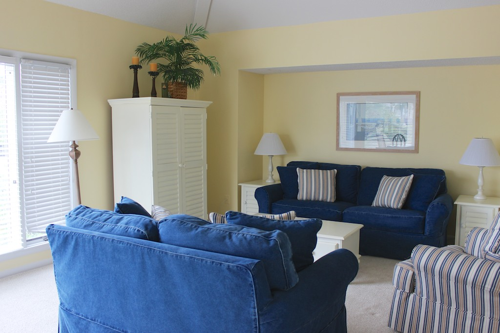 This large and bright living room is a great place to gather on your vacation.