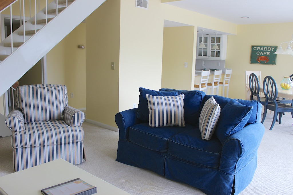 This lovely beach house has an open floor plan and cathedral ceilings.