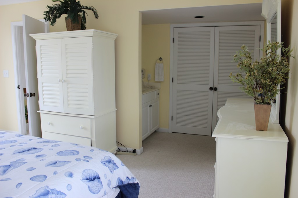 The master bedroom has a large walk-in closet and en suite bath.