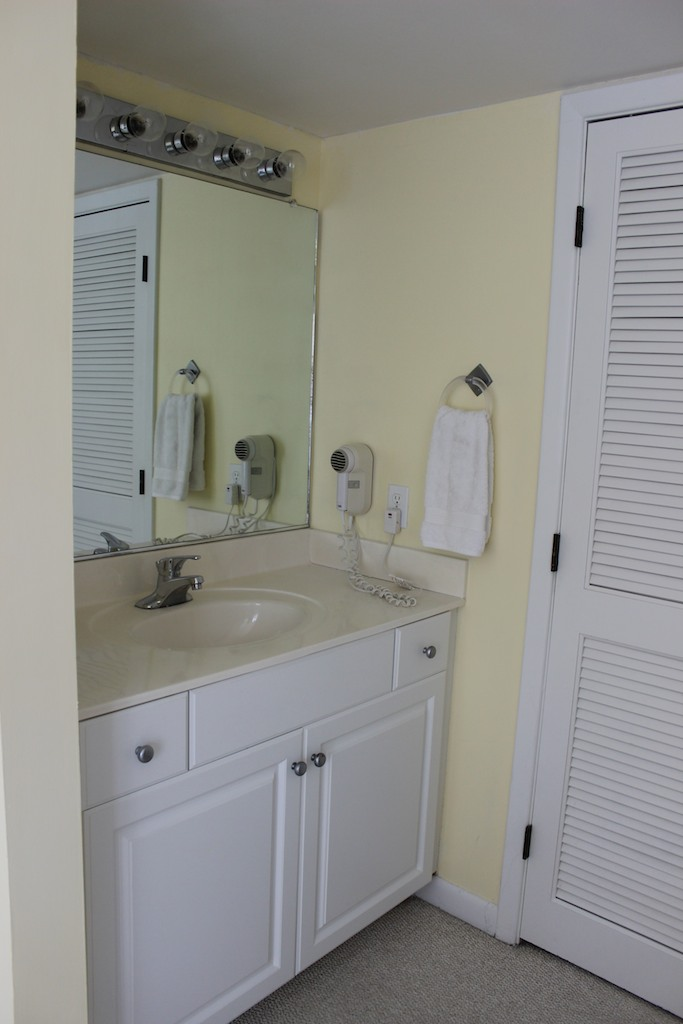 The sink area is separate from the shower and toilet.