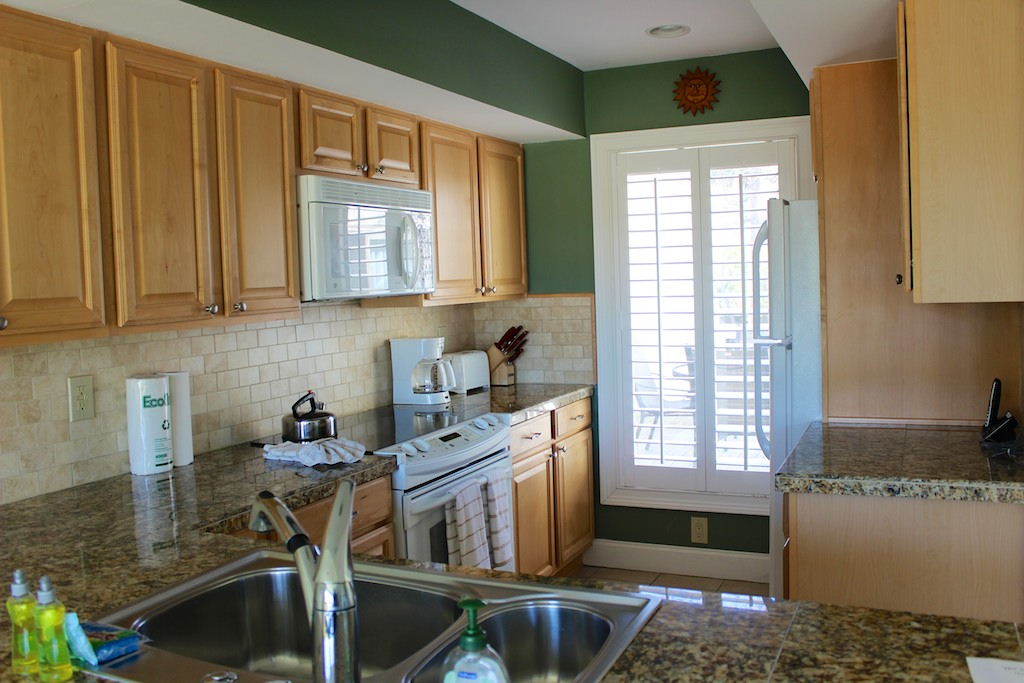 Features include gleaming granite counters, and new appliances.