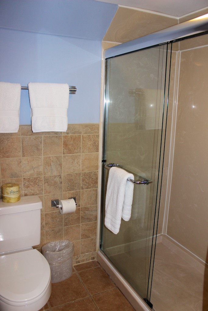 There is a separate room with an oversized shower.