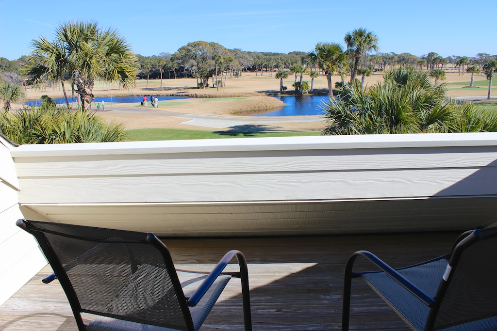 Step onto the deck accessible from the master bedroom and watch the golfers beyond.
