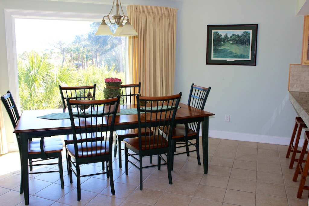 The wall of windows offers views of the lush tropical Seabrook landscape.