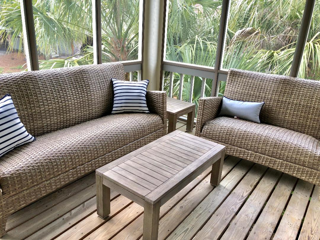 Comfortable seating to enjoy the screened in porch.