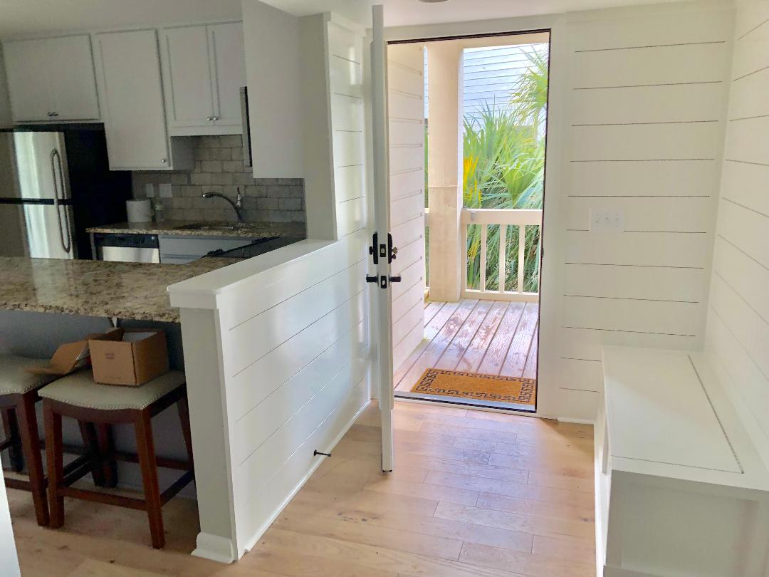 Finishing up renovations - ship lap in entry with bench and open kitchen with granite countertops, stainless steel appliances!