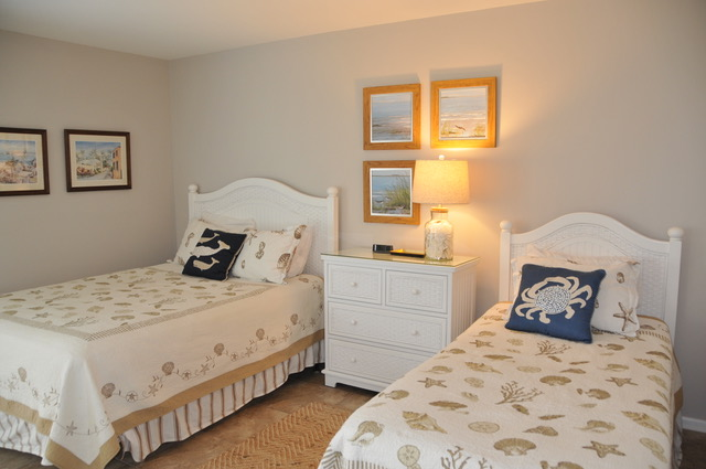 The first floor guest bedroom has a queen and twin bed, sleeping 3.