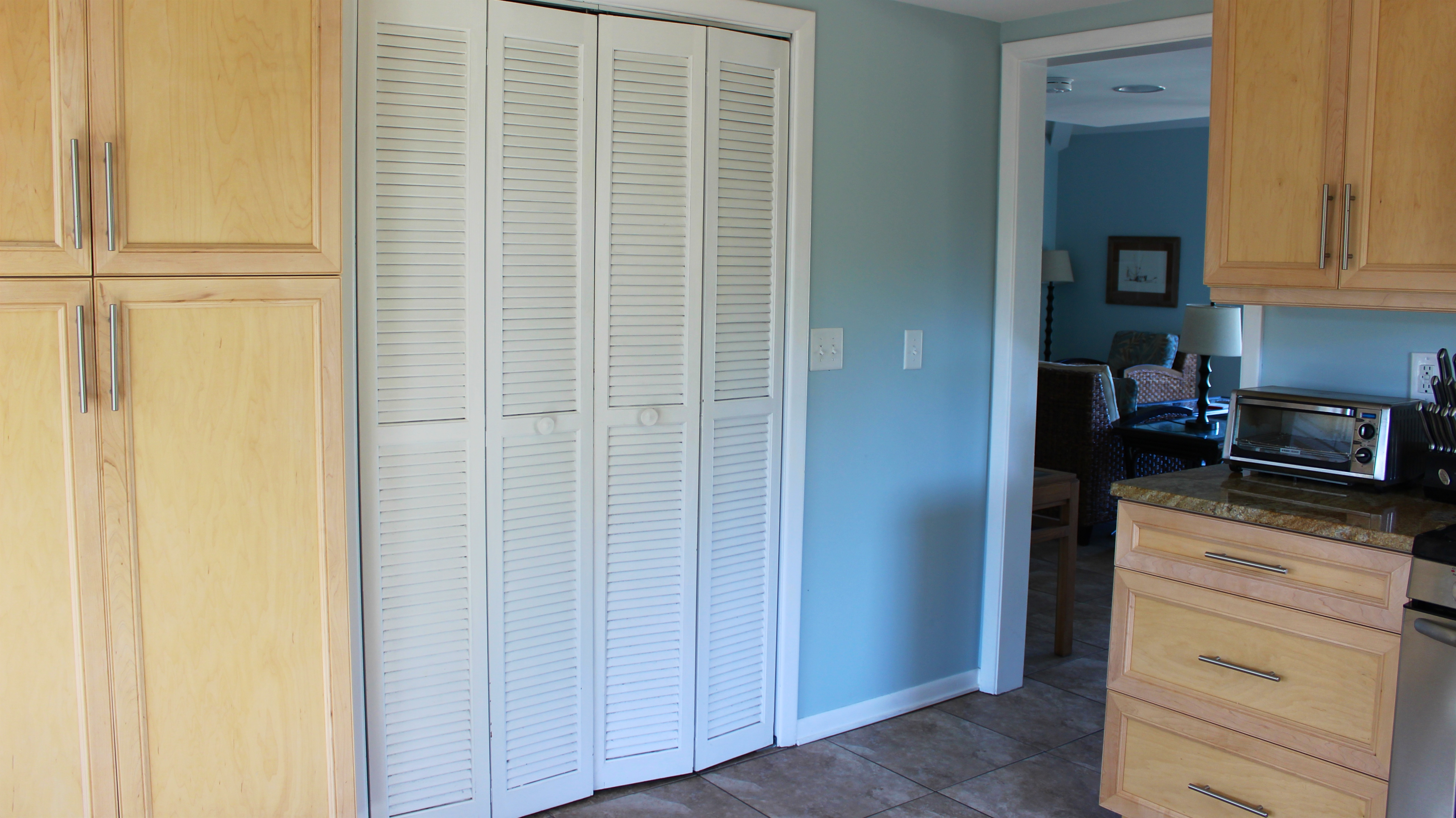 There is a pantry and roomy laundry closet with a full sized washer & dryer.