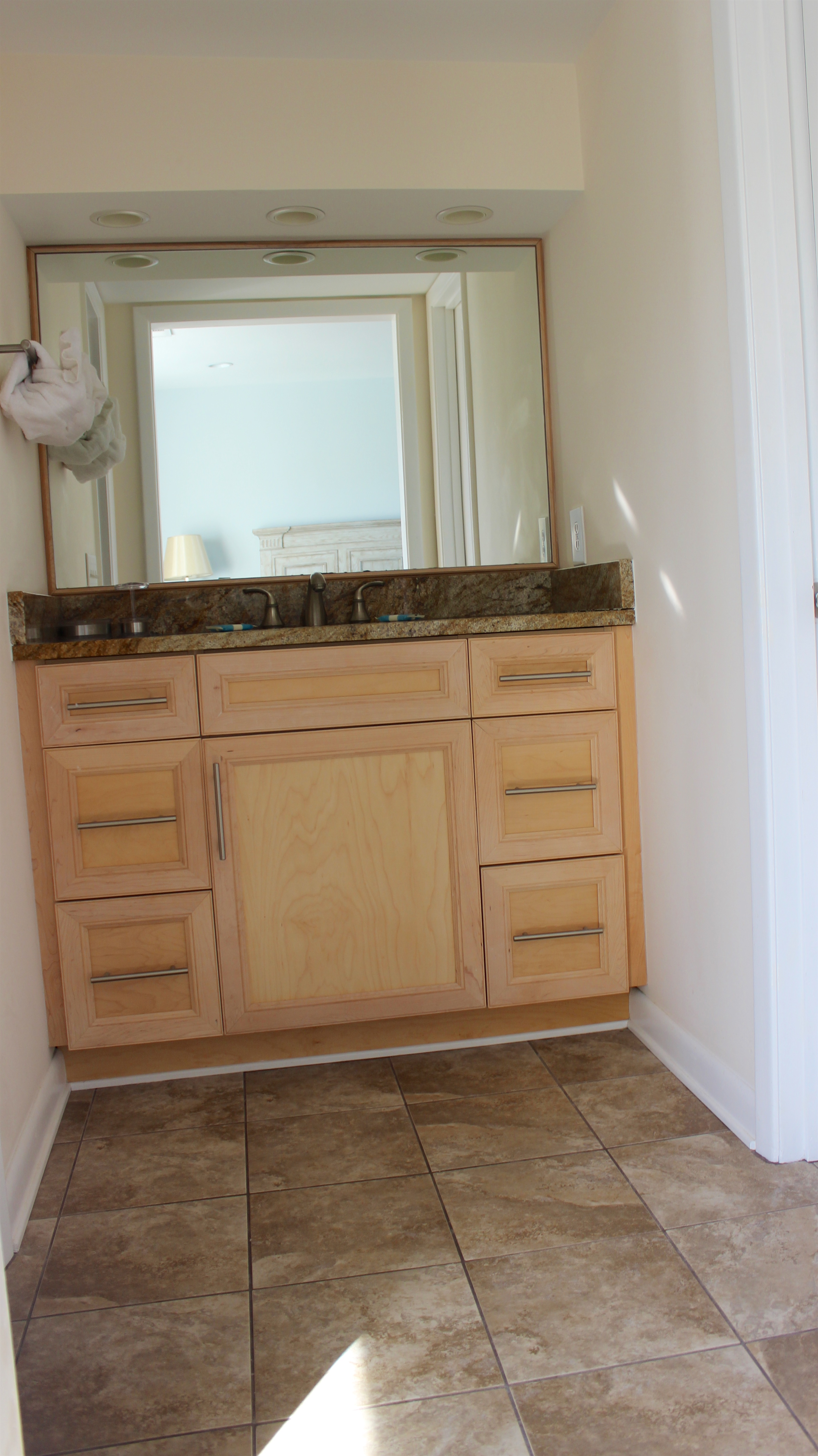 There is a separate sink area with a granite topped vanity in the master bedroom.