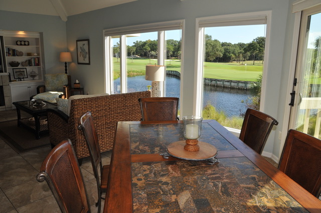 Share stories around the table for 6. Doors lead to a sunny deck.