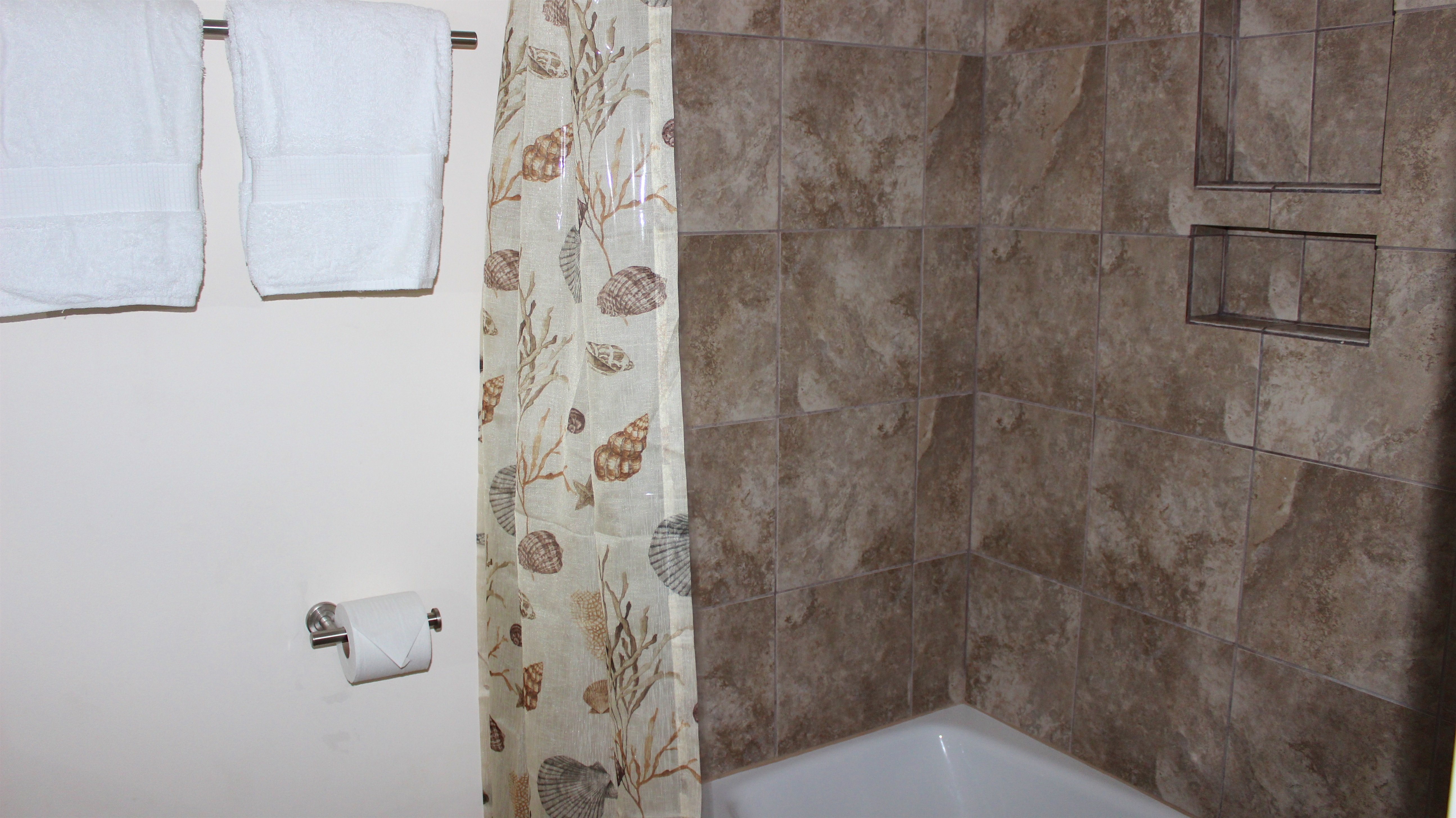 And a tiled shower/tub.