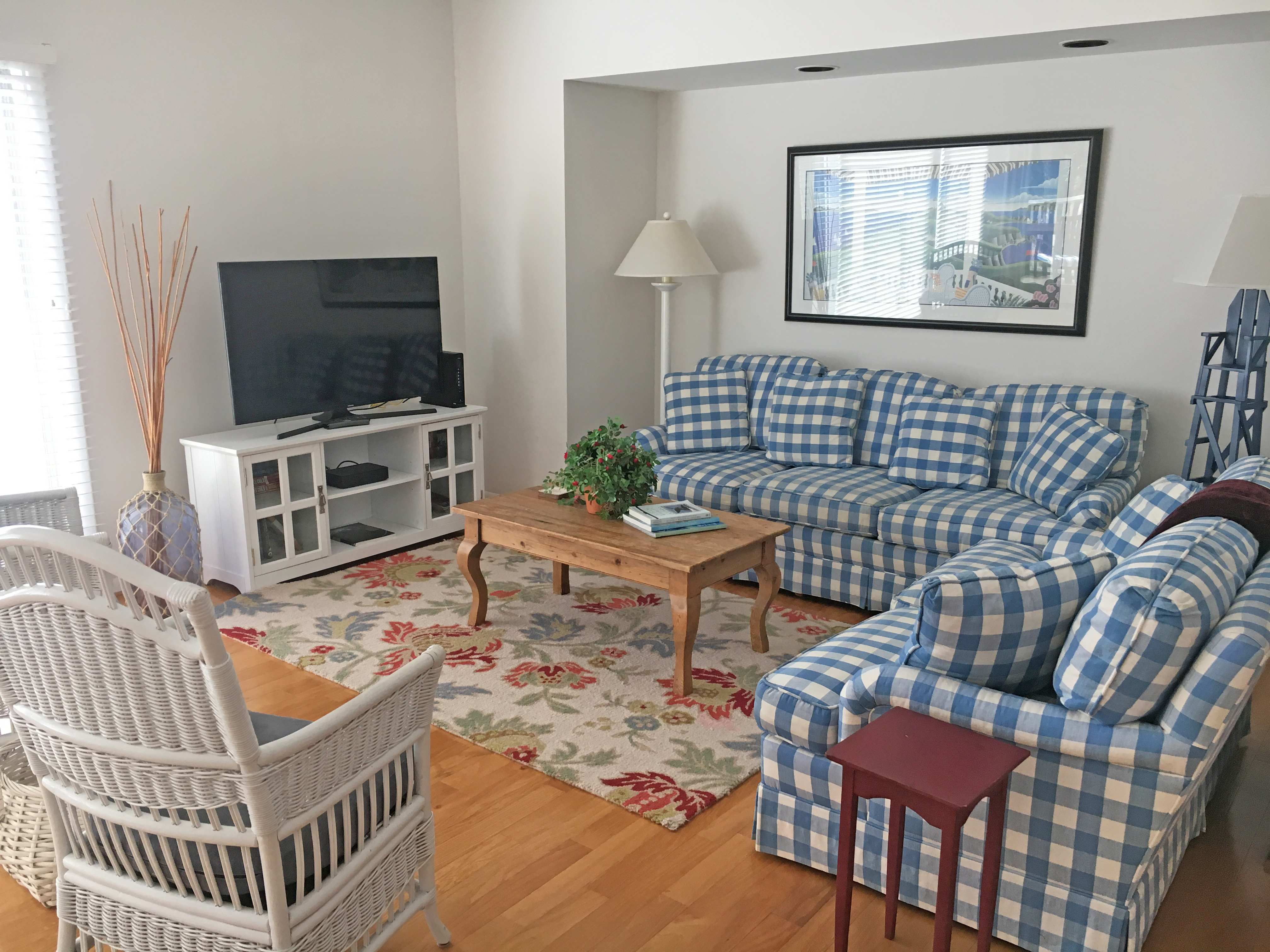 Beautifully remodeled Spinnaker with two bedrooms, two bathrooms, sunroom, and 3 decks.