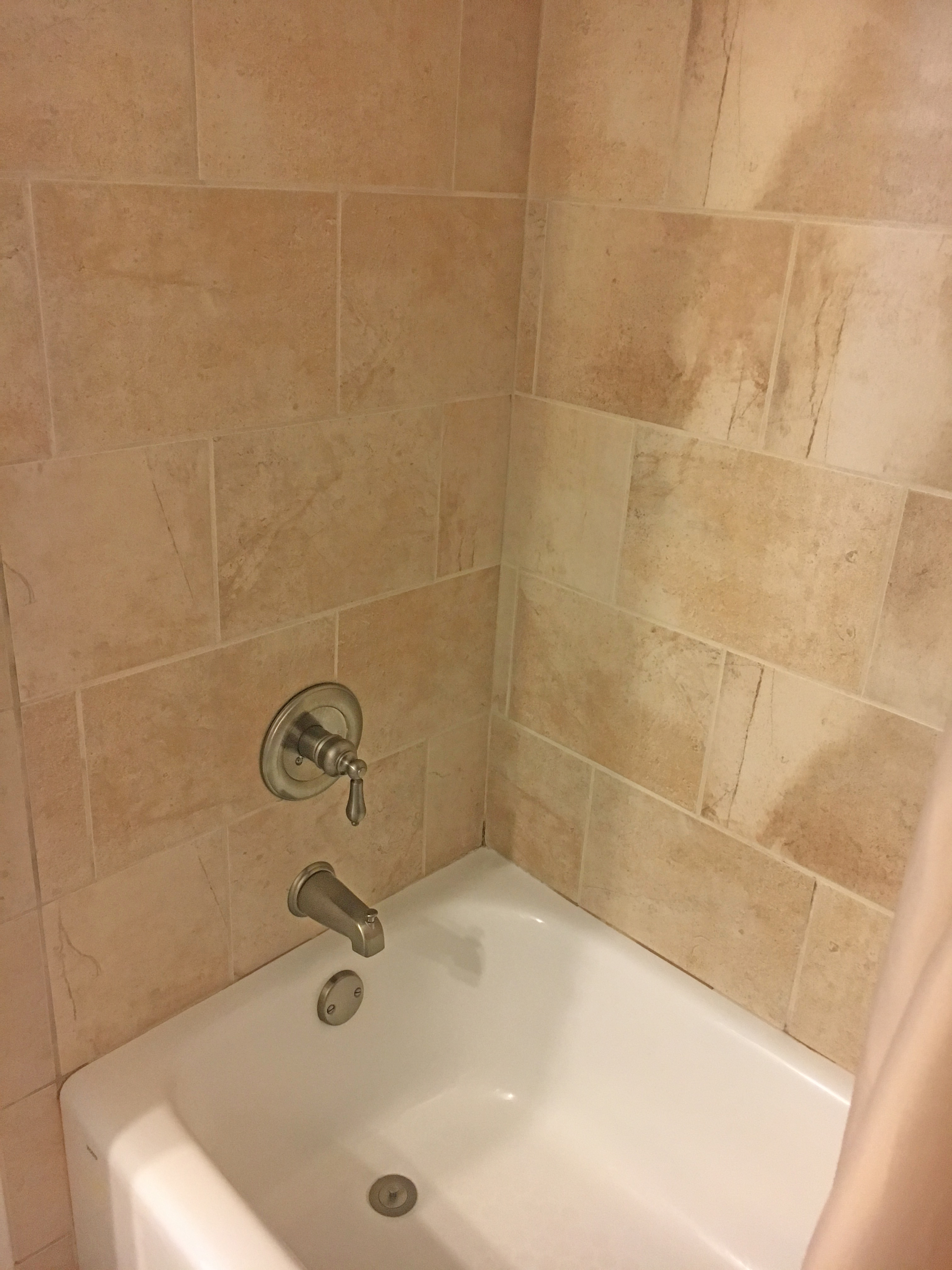 Shower/tub combination in the full bath off guest bedroom on first floor.