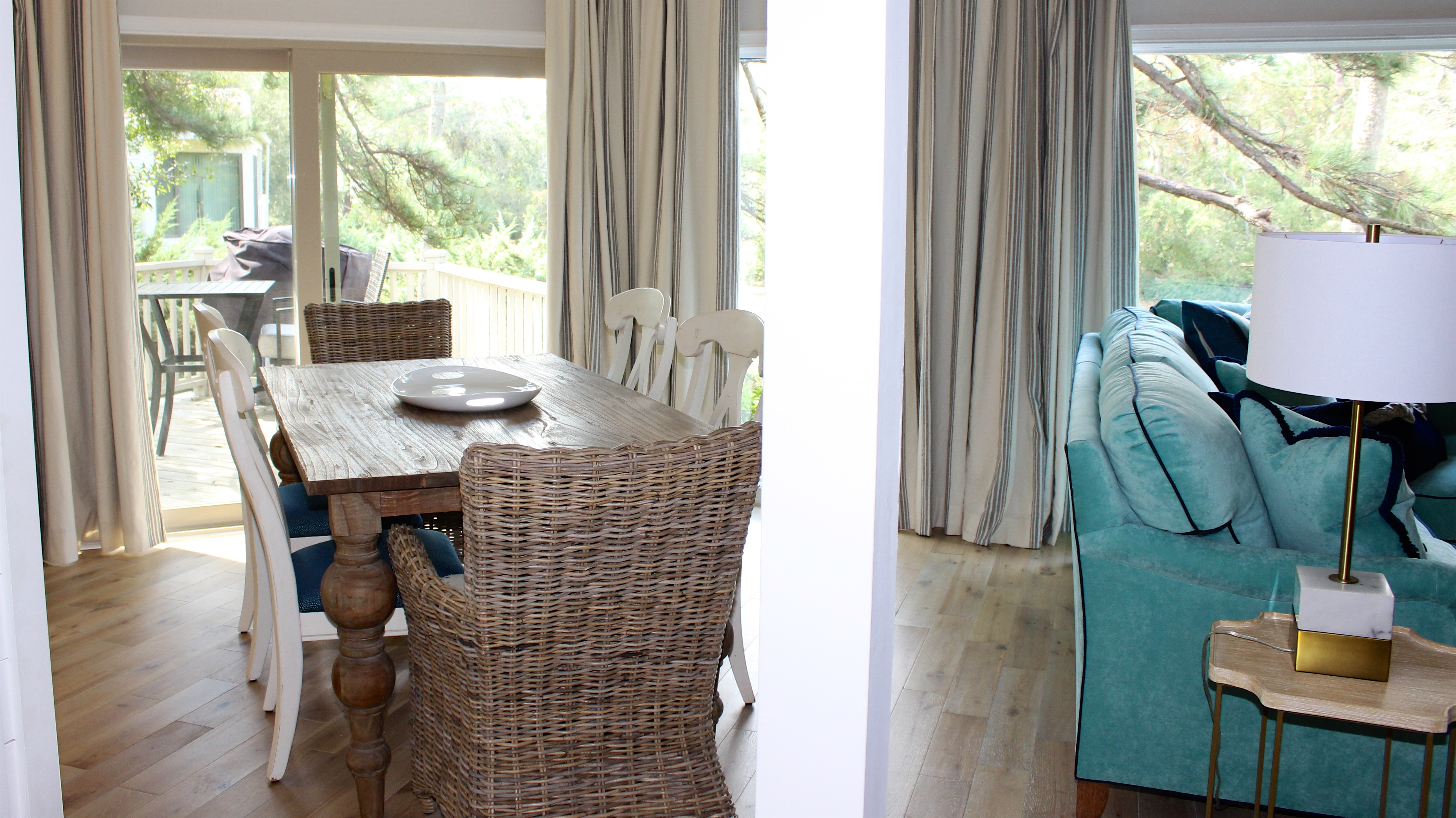 The dining area features a farm table with seating for six.